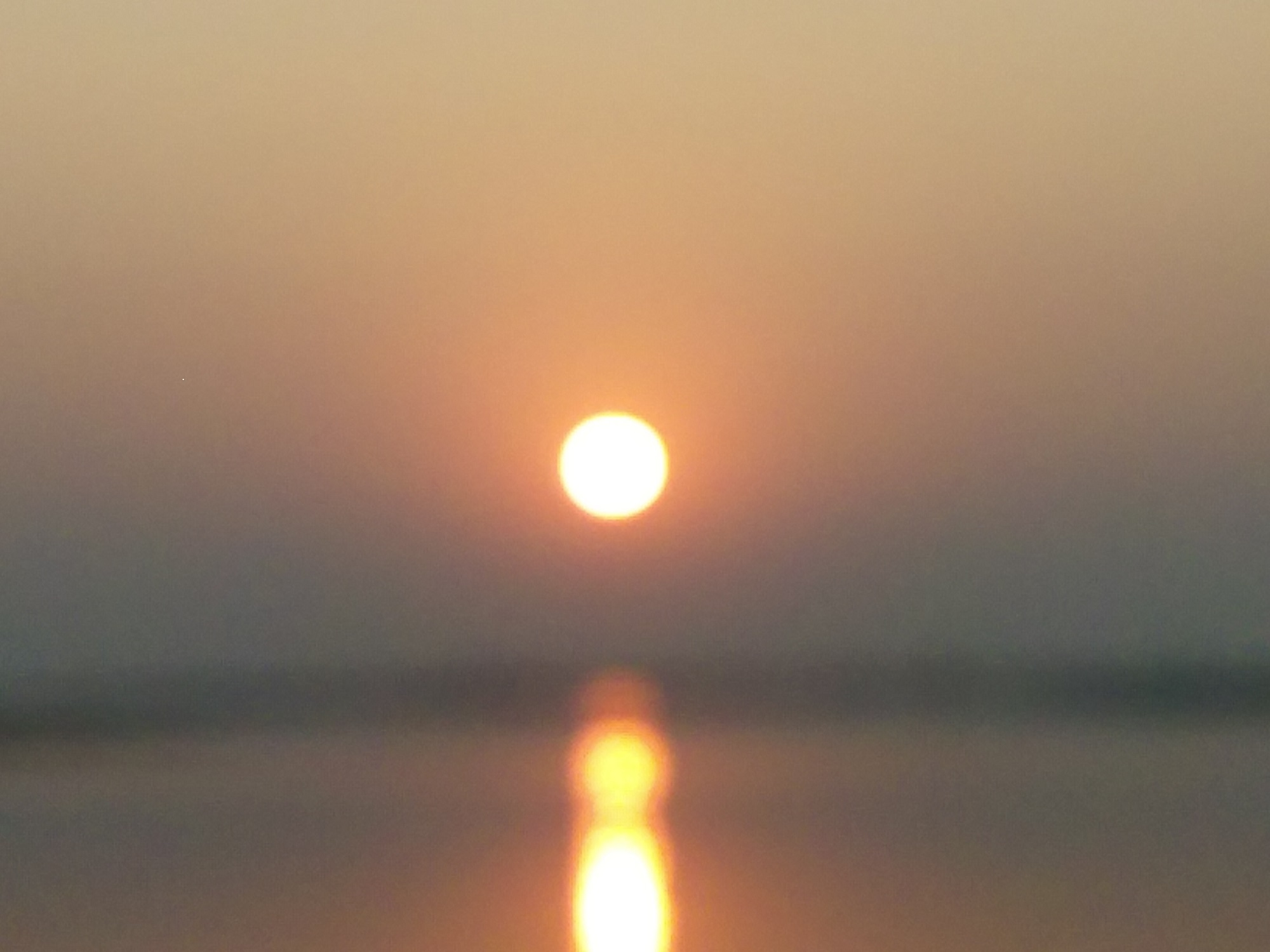 This is capture at Ganga river on sunset. It is a sign of peace, after daylong work or journey. It has the power to change, OUR MIND.