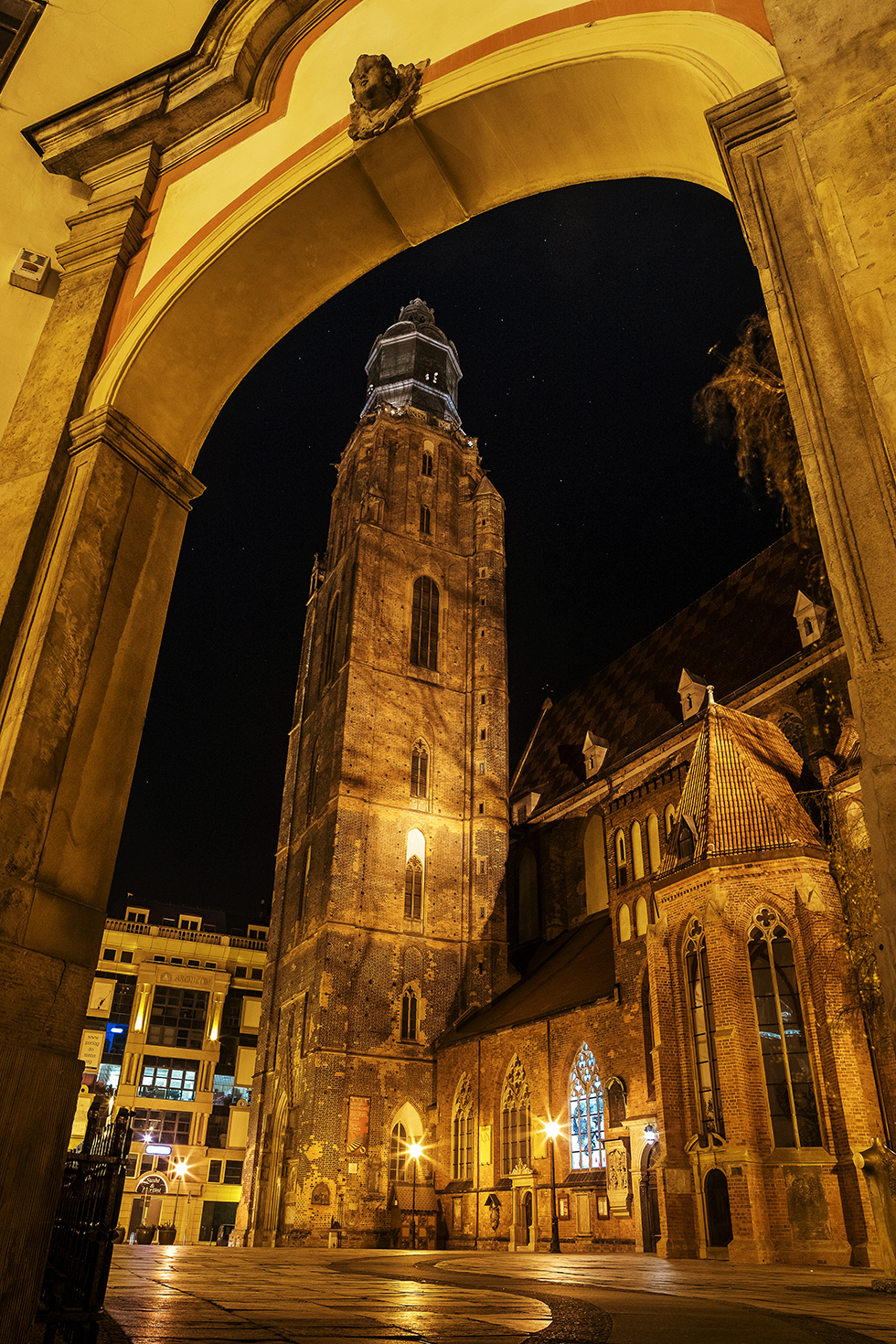 This is one of the famous church in rynek , wroclaw poland , the challenging things in photographing tall architecture at night is composing and avoiding light noise