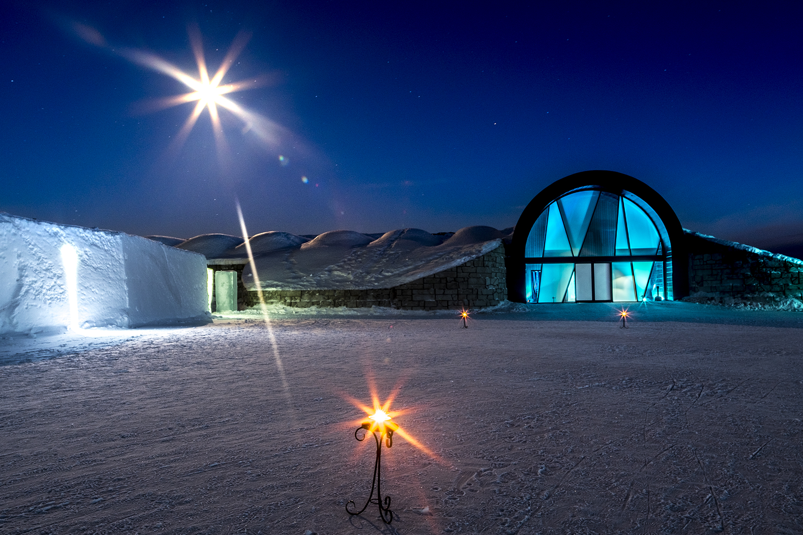 Icehotel in sweden is a world famous ice hotel which is there for the whole year and i used long exposure to make the lights to turn into star and give a feel like star on sky as well as earth