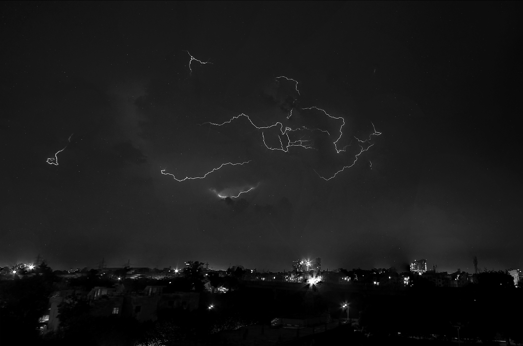 A vehement desire as it states depicts the outcome of the rage of the thunderous clouds resulting in lighting and a desire to uprise emotions and trauma. The photograph is a mere result of 9 shots stitched together on a rainy night in Delhi, India.