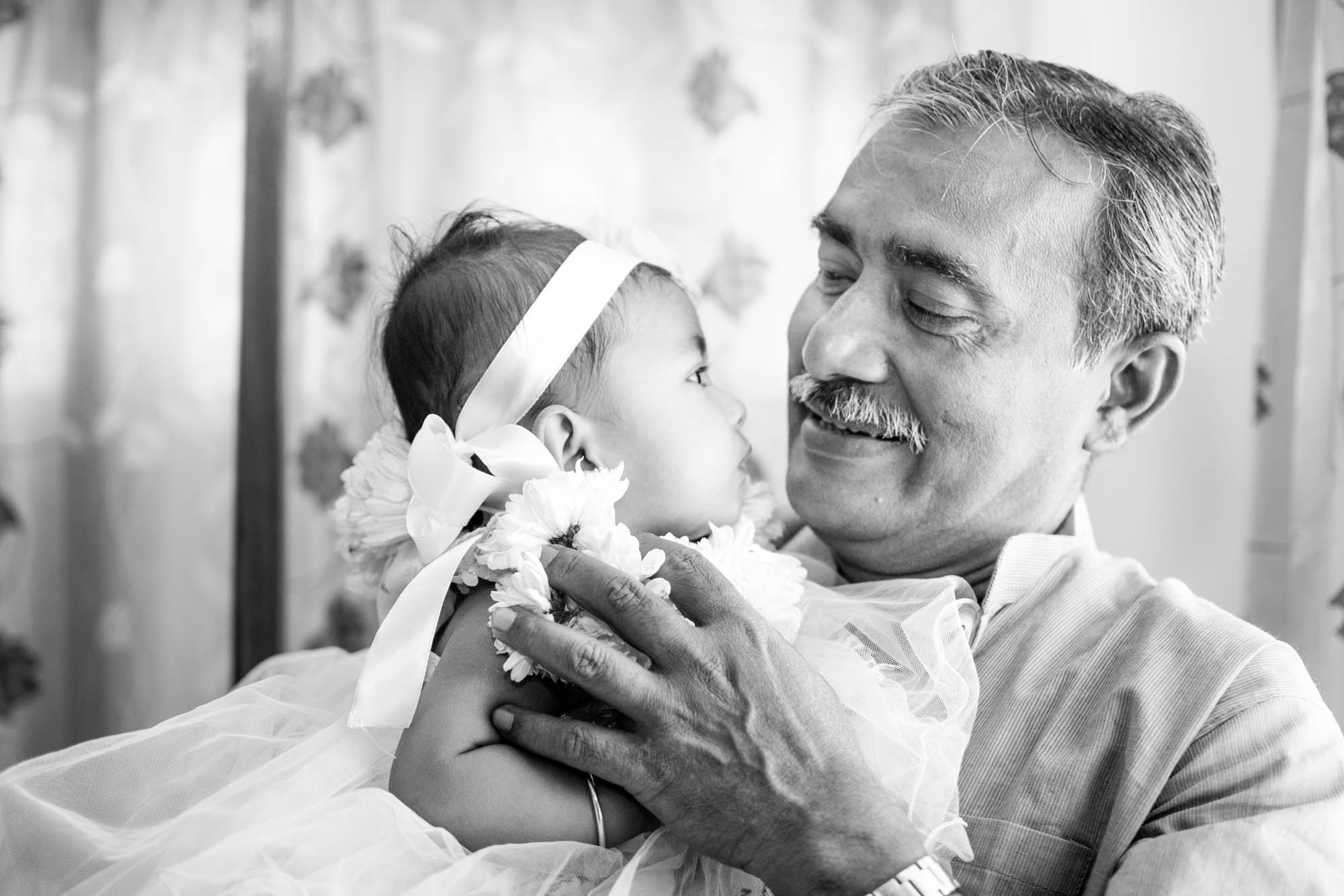 My father whom I can depend on and can took advice in any situation, my friend philosopher and guide...and my daughter is my life...I took this picture in middle of a party where my daughter was fussy and my father took her away from crowd to calm down..she always feel safe in her grandpa's lap...and could not resist to frame the eternal bonding..