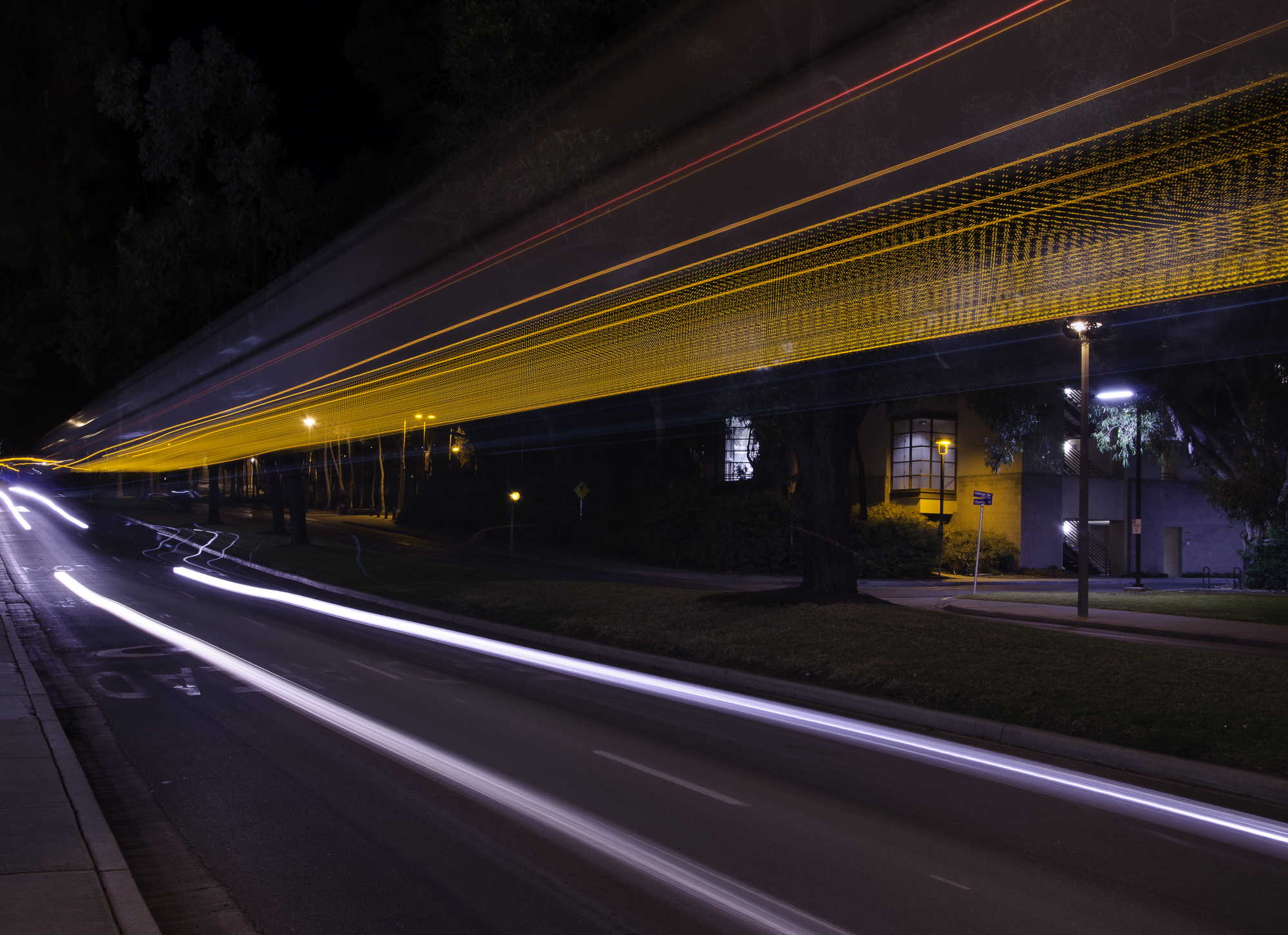 The shot was taken at around midnight with minimum vehicles on road. I took a long exposure  so that I can just capture the headlights of the bus !!