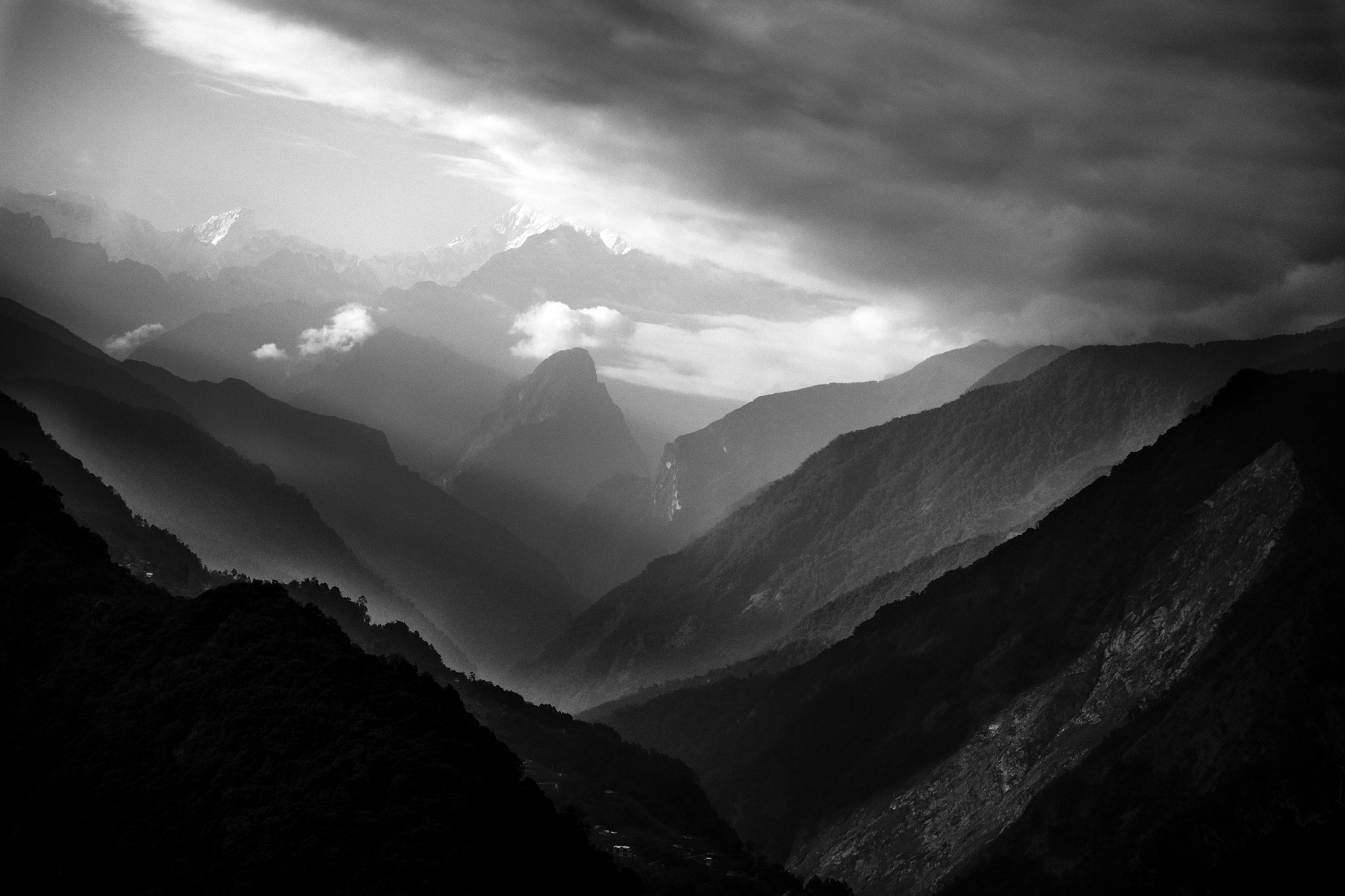 i took this shot while having lunch , suddenly seeing this movement everthing changes into magic light is great , clouds , shadows n layers of mountains .. things start happening n that's moment m waiting for  my photography is all depend on nature you only getting bored nature gives you