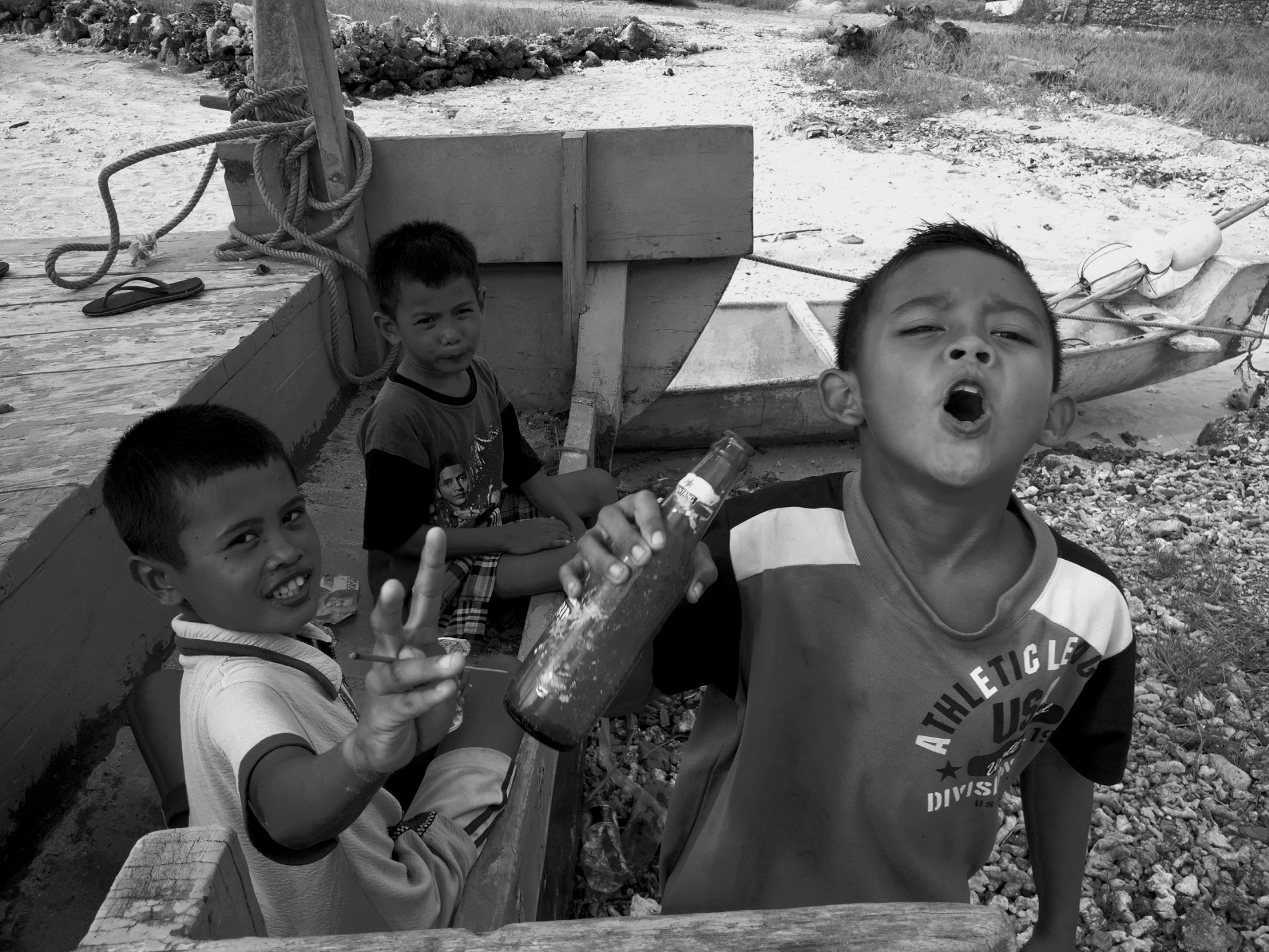 Three kids imitating adult activities like gambling, drinking and smoking. I was quite surprised to see these kids do that while playing. They probably experience  this scenario everyday involving their parents and other elder folk at their homes doing these same things.  It was a powerful message delivered to me at least and we should learn that we as adults have to be more responsible and sensitive on such issues especially when children are involved.Children are inspired by their parents and elders in both positive or negative ways.