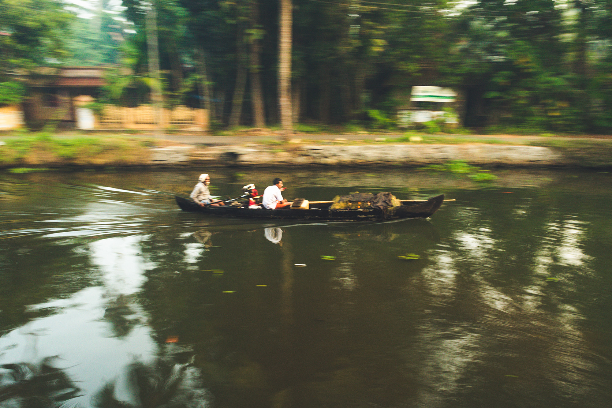 This photo was taken in the early hours of the morning. These two men starts the journey to earn their livelihood on their small fishing boat and net. Fishing is the main livelihood for these backwater people.