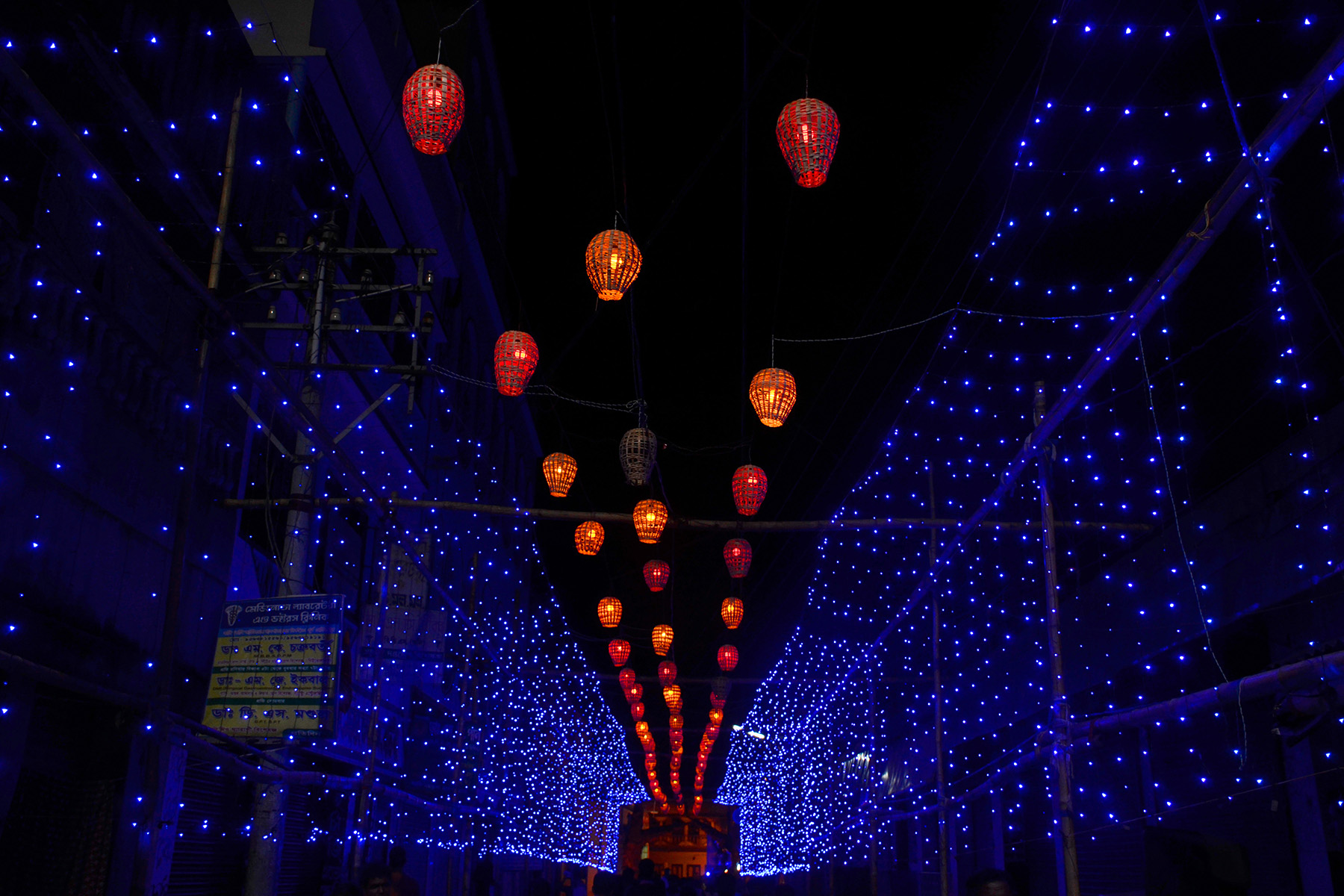 In dark night, the twinkling of blue stars with globe light show the path very nicely.