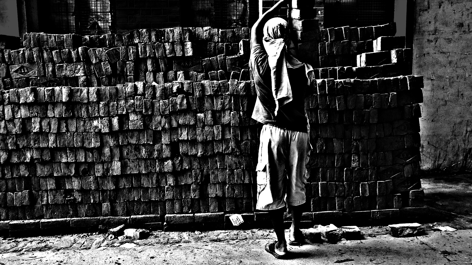 I love taking street shots like this ...This shot has been taken in my street I live at where a labourer loading bricks on his shoulder to and shifting these bricks on the second floor...his technique was great as it is too hard to load something on one's shoulder...