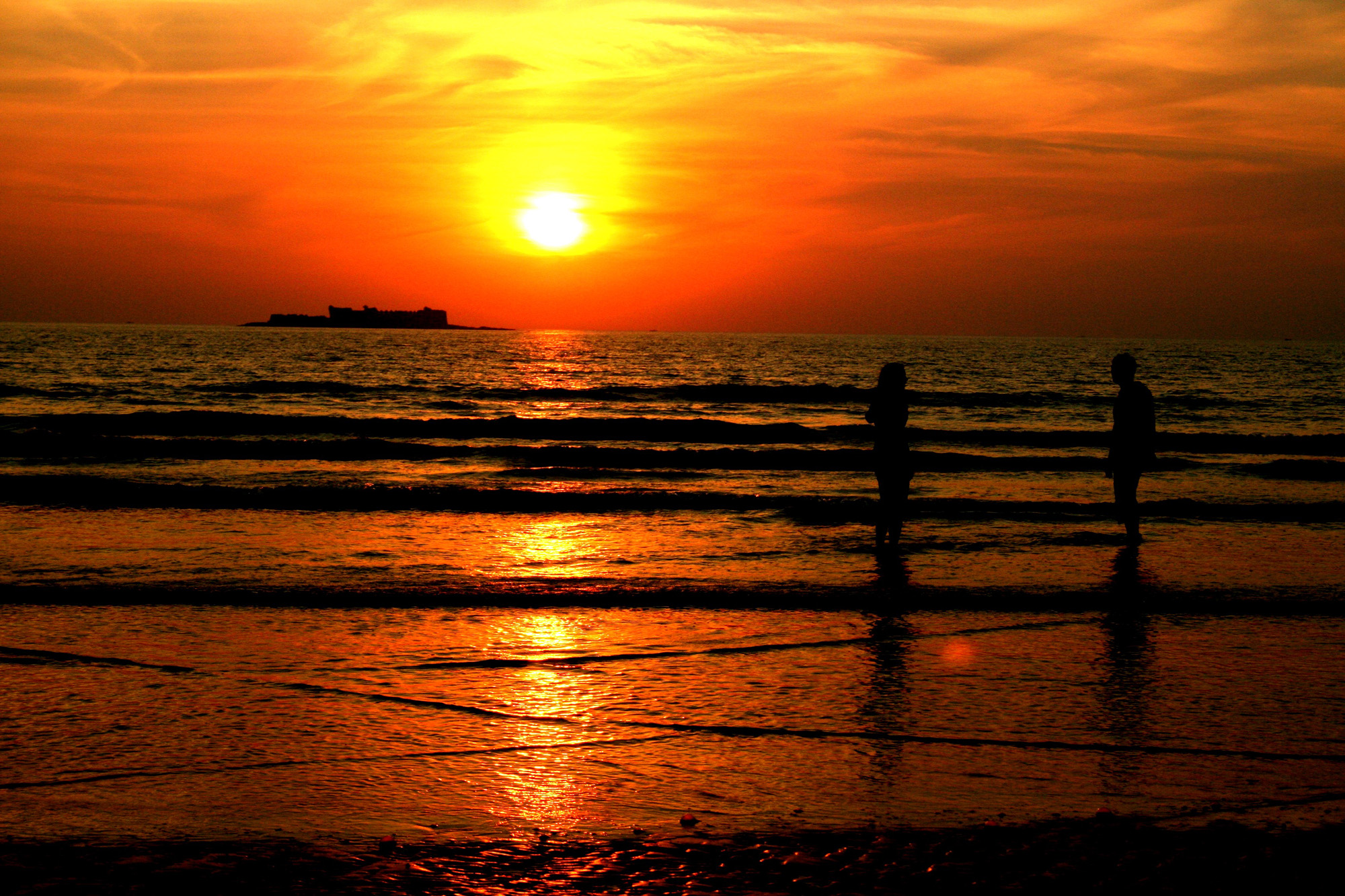 we were at ganapati pule beach in kokan,maharashtra. i was on tne beach at the right moment to catch the golden sunset. I made my daughter and son to stand and captured their silhouttes.