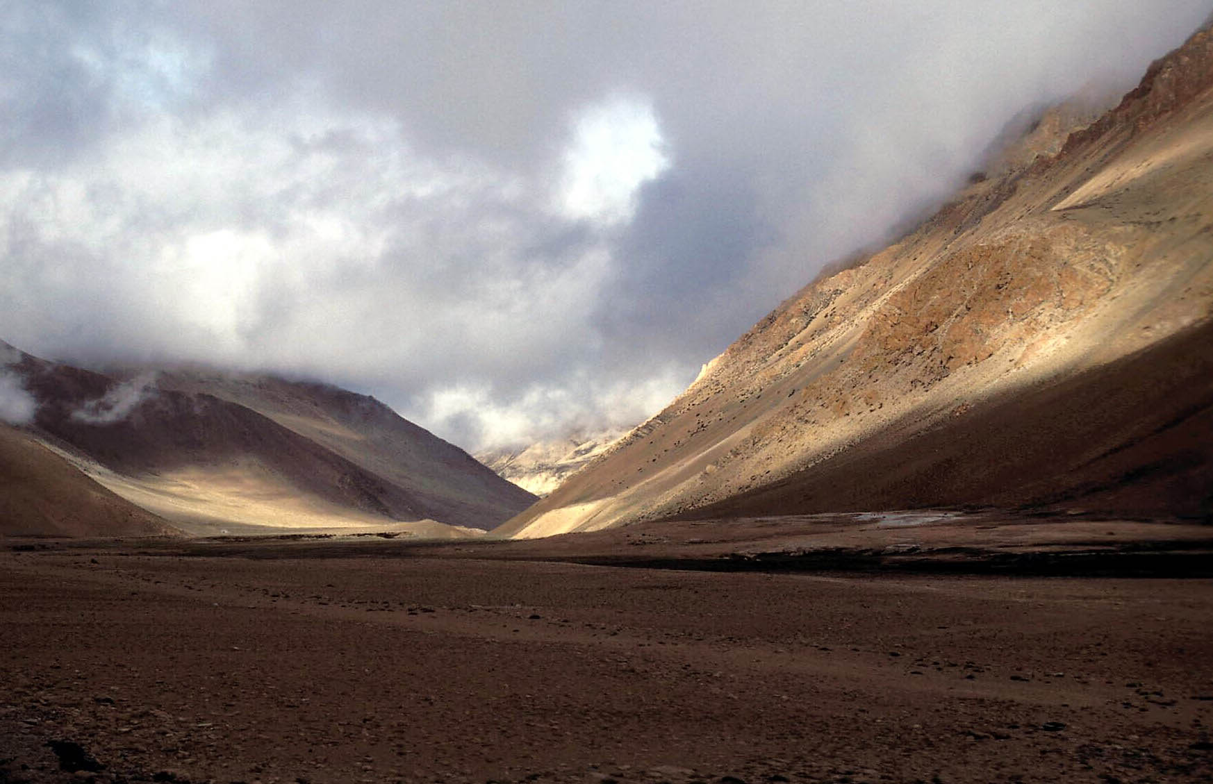 we were travelling in Tibet on our way to kailas and mansarovar. The entire landscape was barren ut the play of light and shadows cast a beautiful spell.