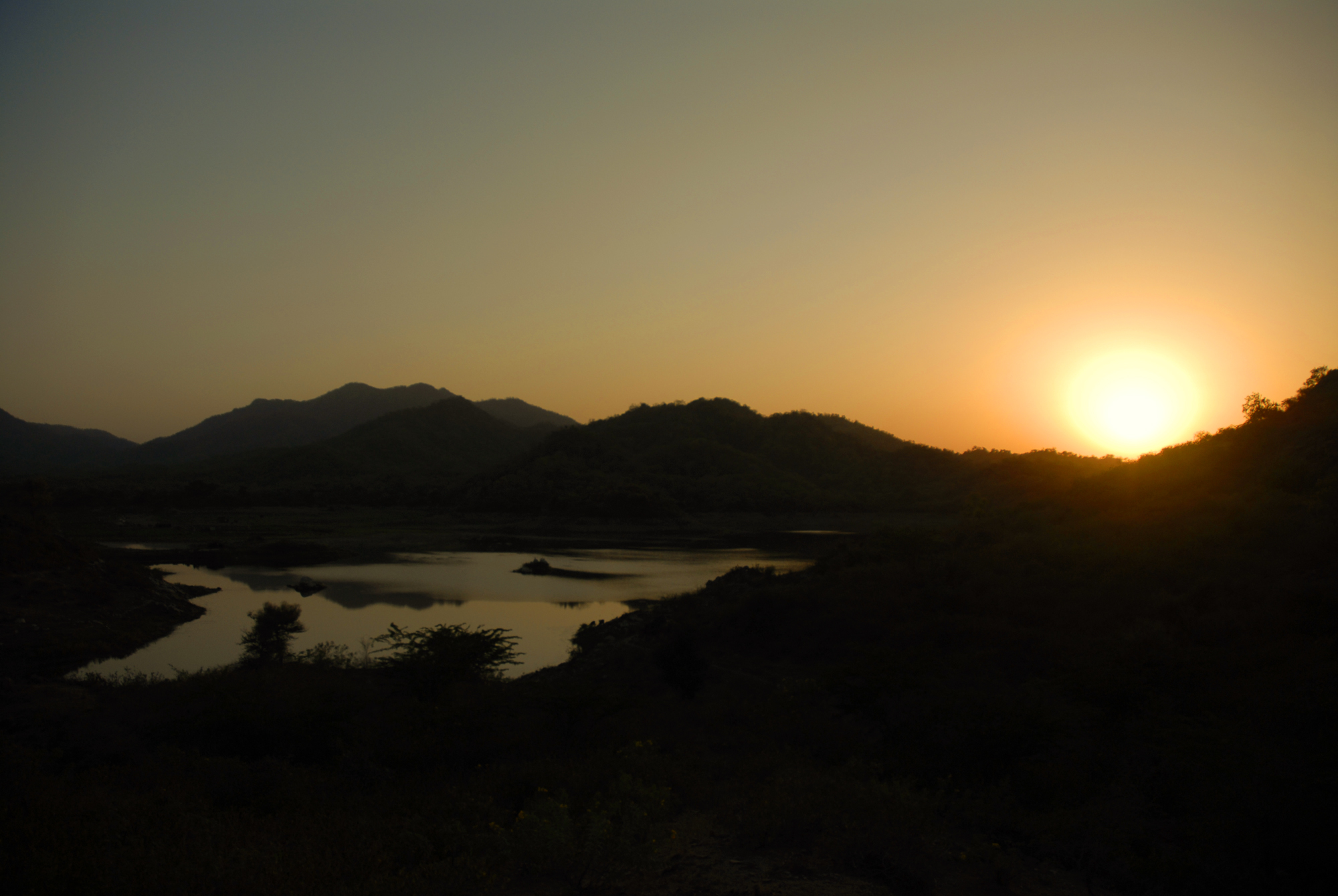Photo by Kristian Bertel - This beautiful evening sunset landscape was photographed near Ranakpur in Rajasthan, India. Ranakpur is a village located in Desuri Tehsil near Sadri Village in the Pali district of Rajasthan. Though a large percentage of the total area is desert, and even though there is little forest cover, Rajasthan has a rich and varied flora and fauna.