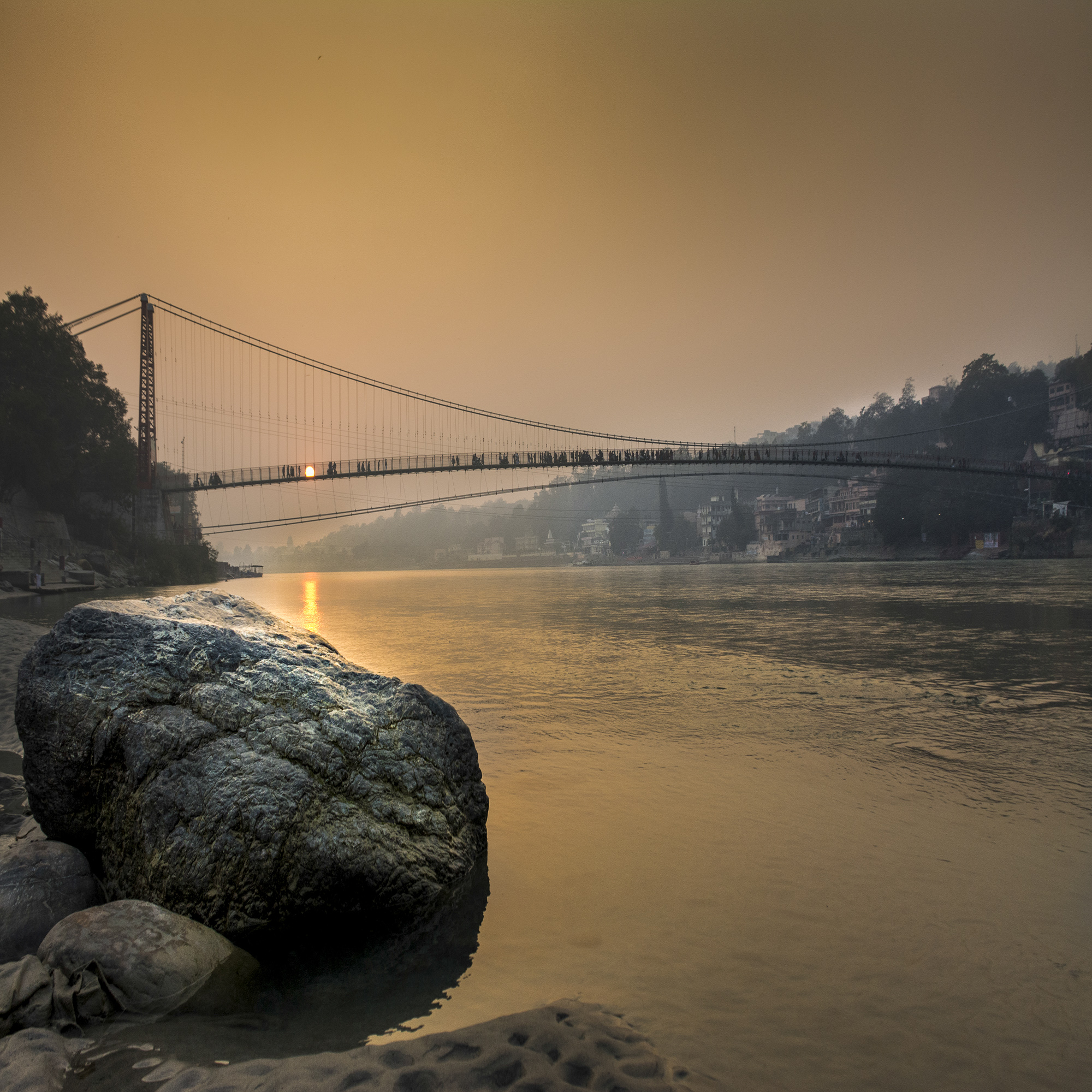 Rishikesh is not only the yoga capital of the world but there is much more one looks for.. it has serenity, beautiful bridges, beeches,people and yes the holy Ganga. i took this image near Ramjhula.