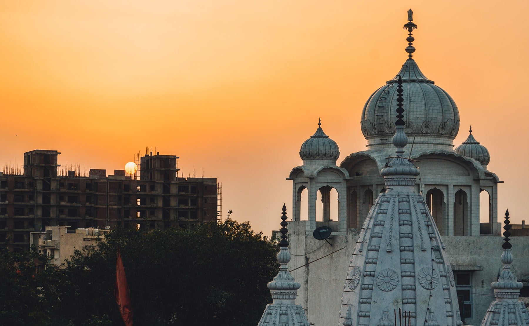 Under the orange sky is where the magic begins.  Location : Delhi