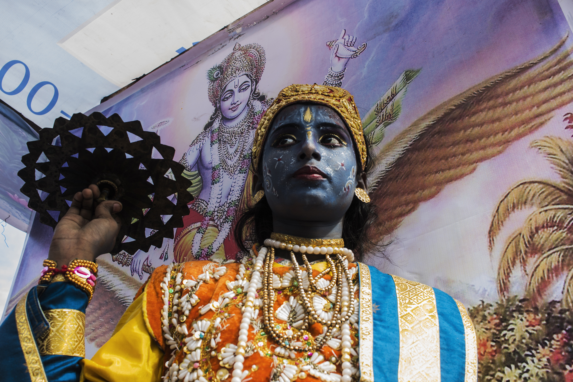Young Devotee took disguise of God Bishnu in Chariot Festival and was standing in front of the image of Lord Vishnu