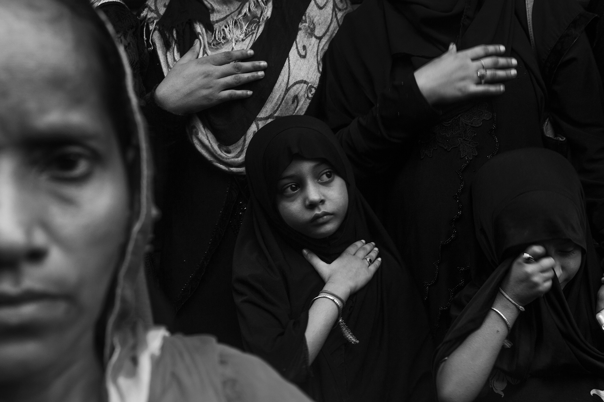 In Muharram, The Muslim women and children were watching the procession from a remote place and beating their chest with hand to celebrate this event.