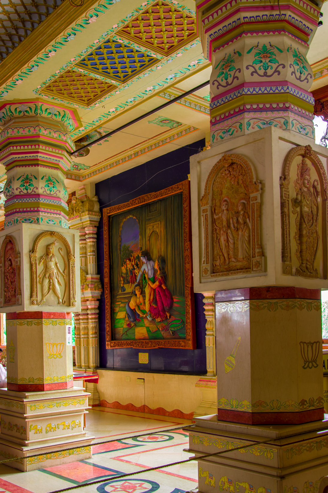 Captured this inside the temple. There're beautiful paintings and art work on every inch of the temple. Framed the painting through the beautiful pillars.
