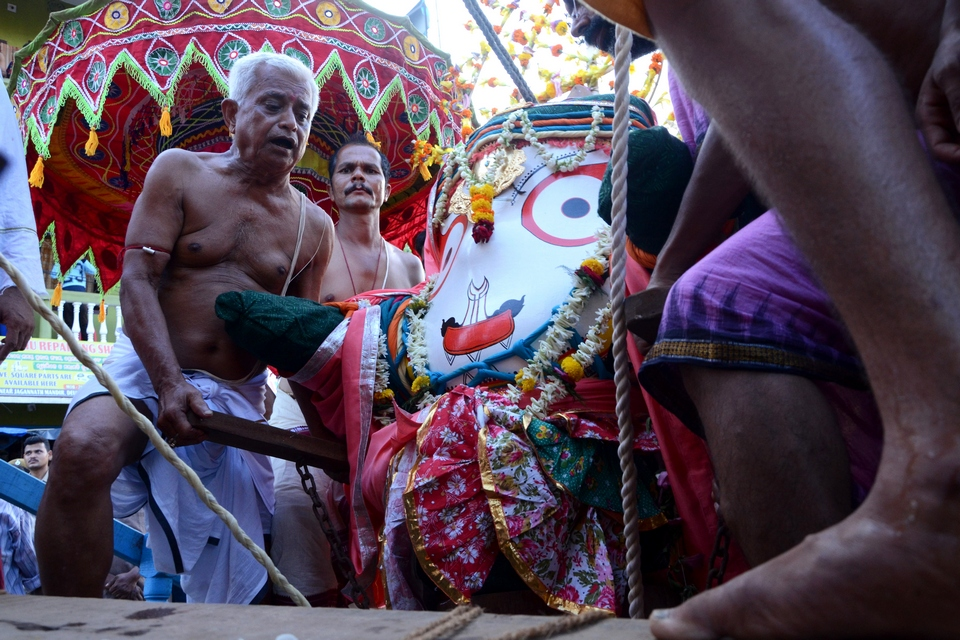 GOD IS BEING CARRIED TO THE CHARIOT FROM HIS TEMPLE ON THE OCCASION OF RATHAJATRA AT BARIPADA