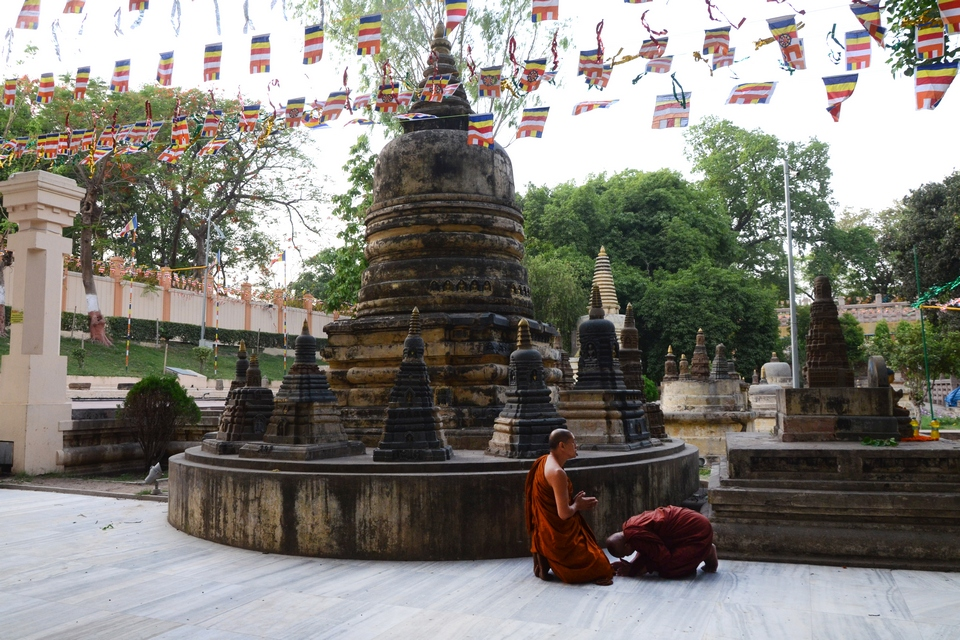 MONKS ADMIRING AND SALUTING EACH OTHER AT BODHGAYA ON THE OCCASION OF BUDDHPURNIMA