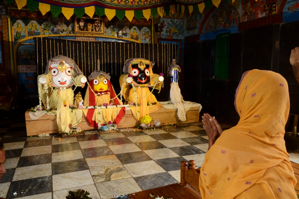 THE LADY WORSHIPING LORD JAGANNATHA AND HIS BROTHER & SISTER ON THE OCCASION OF RATHAJATRA AT BARIPADA WHEN THE LORD CAME INTO THE WORSHIPPERS