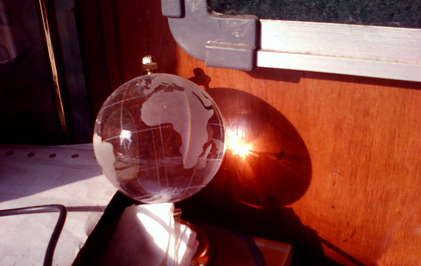 i was studying when i noticed the sun rays falling on the earth globe.. and casting a beautiful pattern beyond it.. i could never miss capturing that