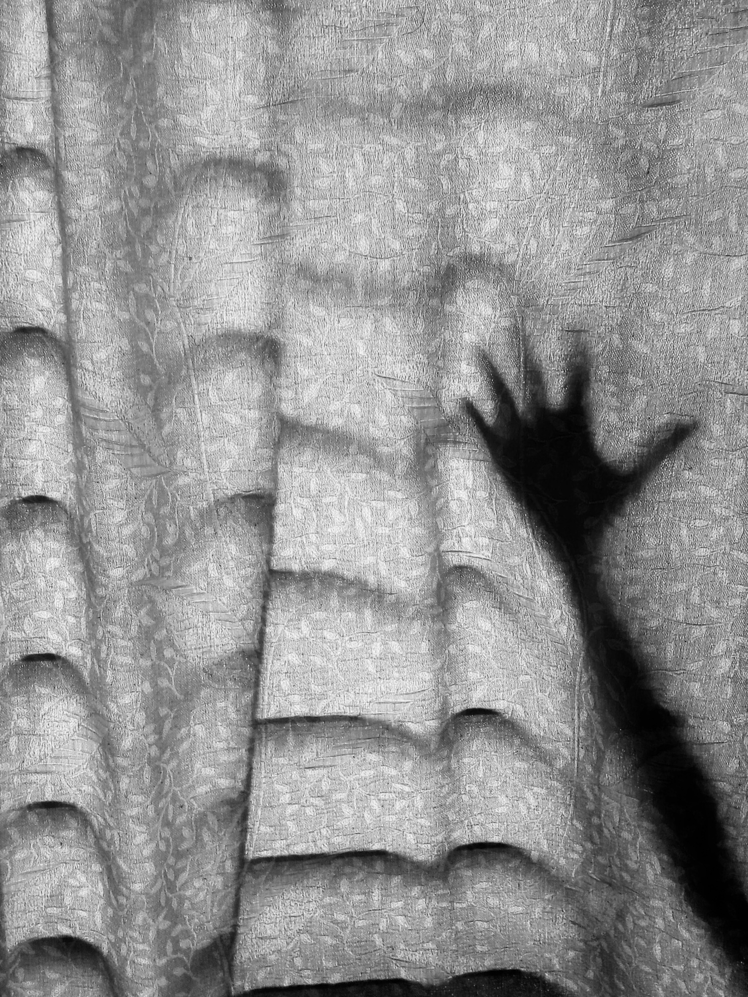 Mother waving hands, behind the curtain, playing with hide and seek with her daughter, in home.