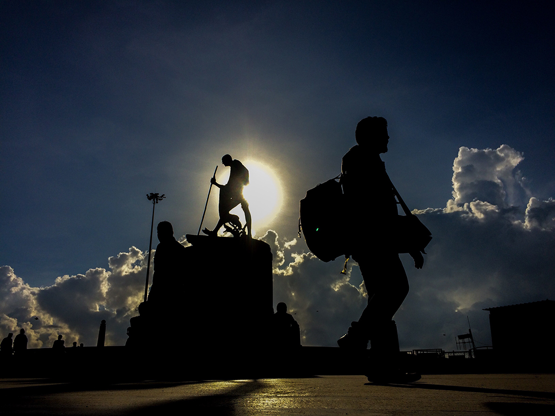 This Image was shot at Marina Beach Chennai. I loved the man who is passing the Gandhi Statue,sunrise and the giant clouds.