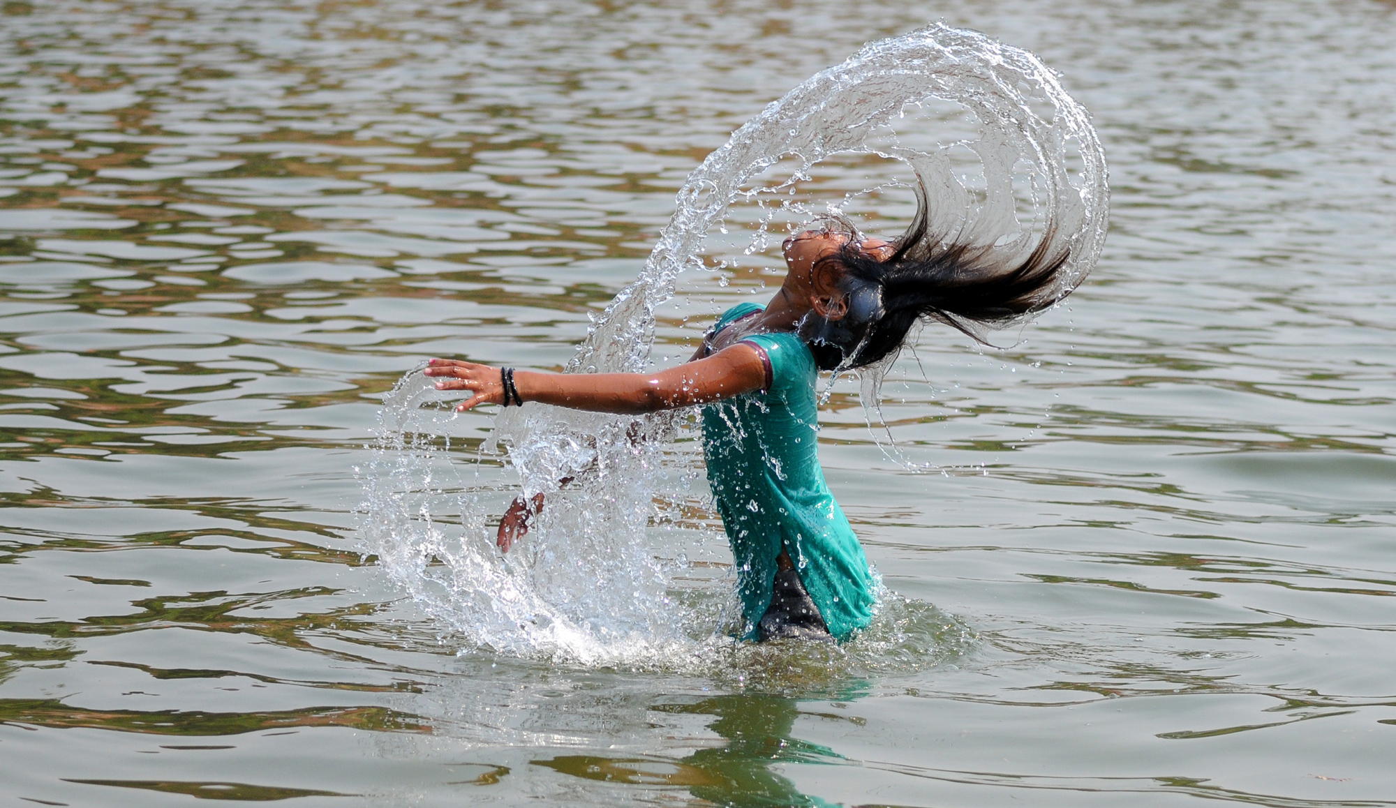A girl Beat the Heat as bathing on a hot summer day at Mini lake, Sector 42 in Chandigarh
