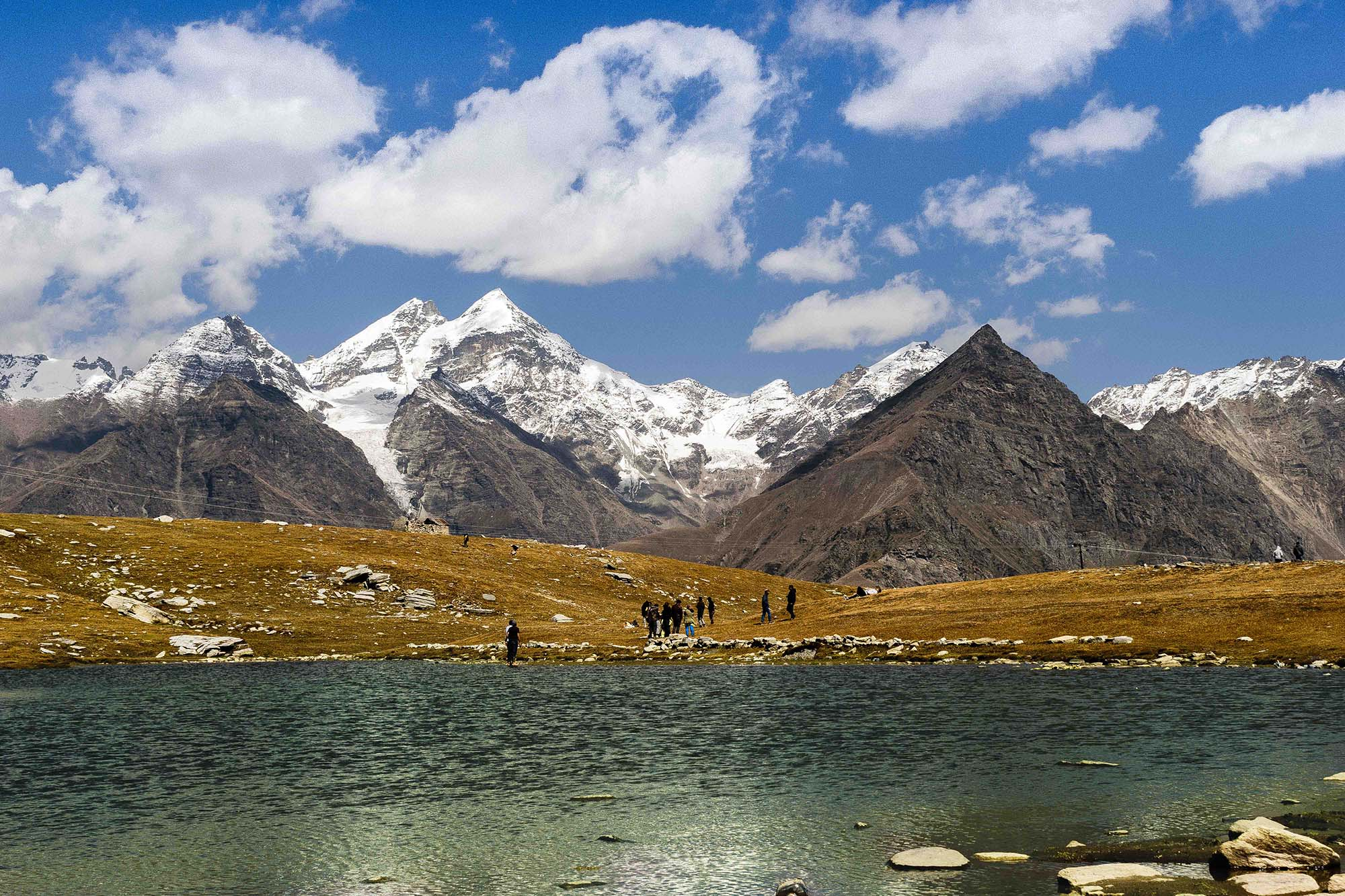 The pass provides a natural divide between the Kullu Valley with a primarily Hindu culture (in the south), and the arid high-altitude Lahaul and Spiti valleys with a Buddhist culture (in the north). The pass lies on the watershed between the Chenab and Beas basins. On the southern side of this pass, the Beas River emerges from underground and flows southward and on its northern side, the Chandra River (flows from the eastern Himalayas), a source stream of the river Chenab, flows westward.