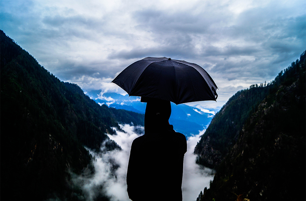 LOCATION: MALANA, HIMACHAL PRADESH   Underneath the storm an umbrella is saying Sitting with the poison takes away the pain Up and up Up and up
