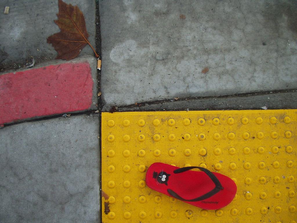FOUND ITEM : flip flop on sidewalk crossing