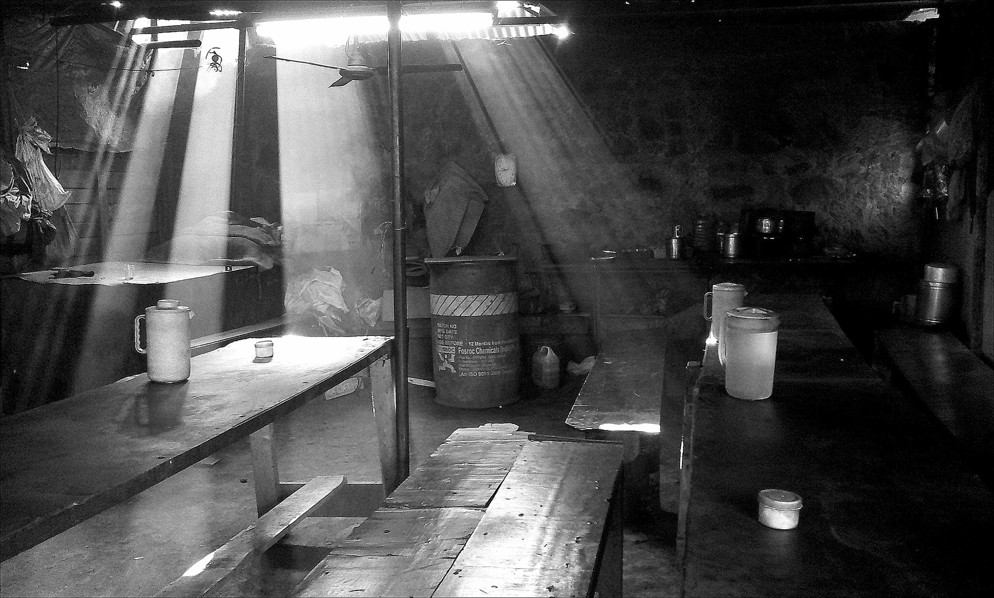 this shot was taken inside a makeshift canteen for  labourers.beams of sun rays falling in the area through the opening of the tin roofs was creating beautiful drama worth capturing
