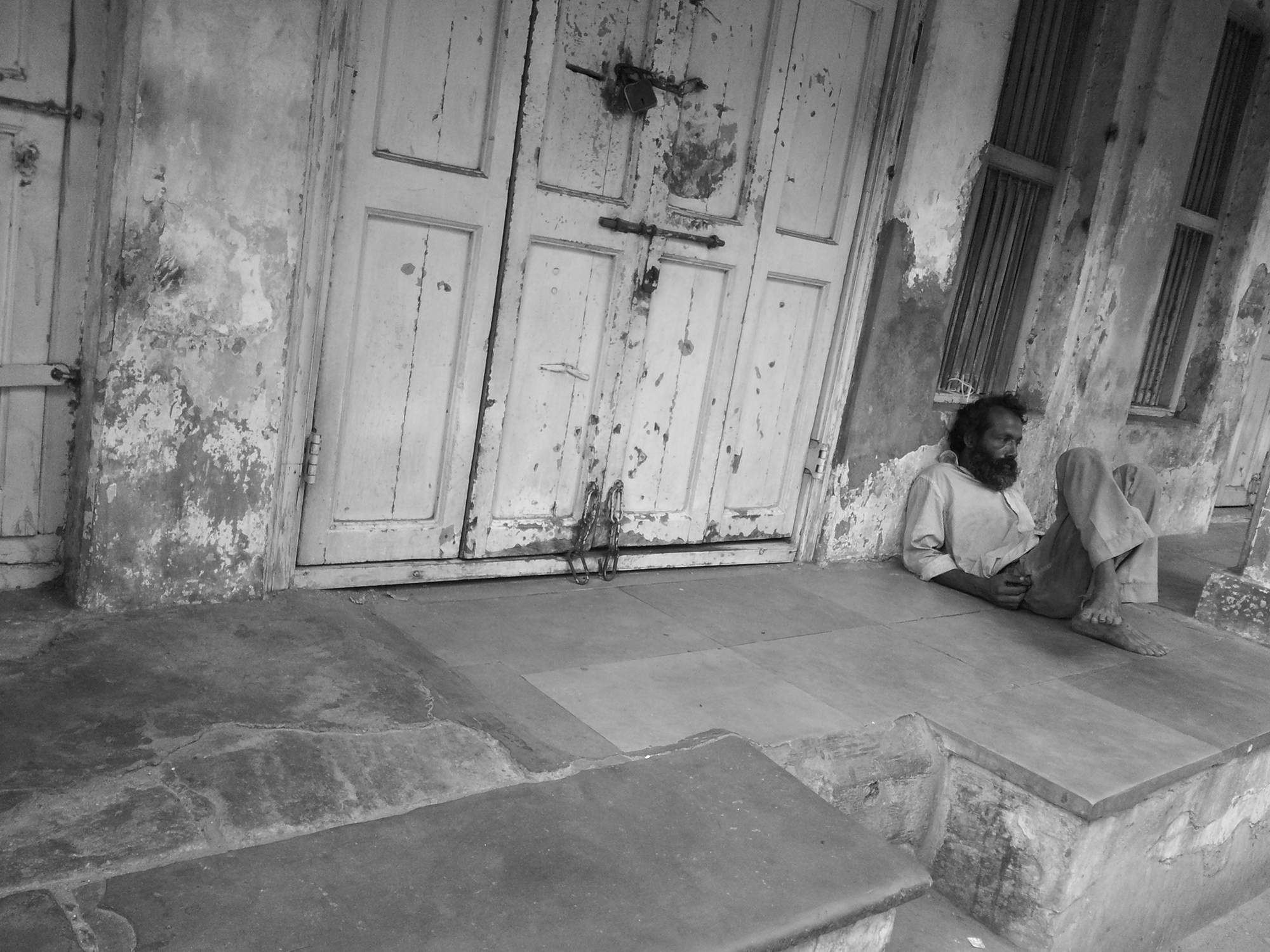This shot was taken on the roads of Ahmedabad.I found this man lost in his thoughts with the ruined house in the backdrop.Both the elements  are complementing each others situation may be the lost glory