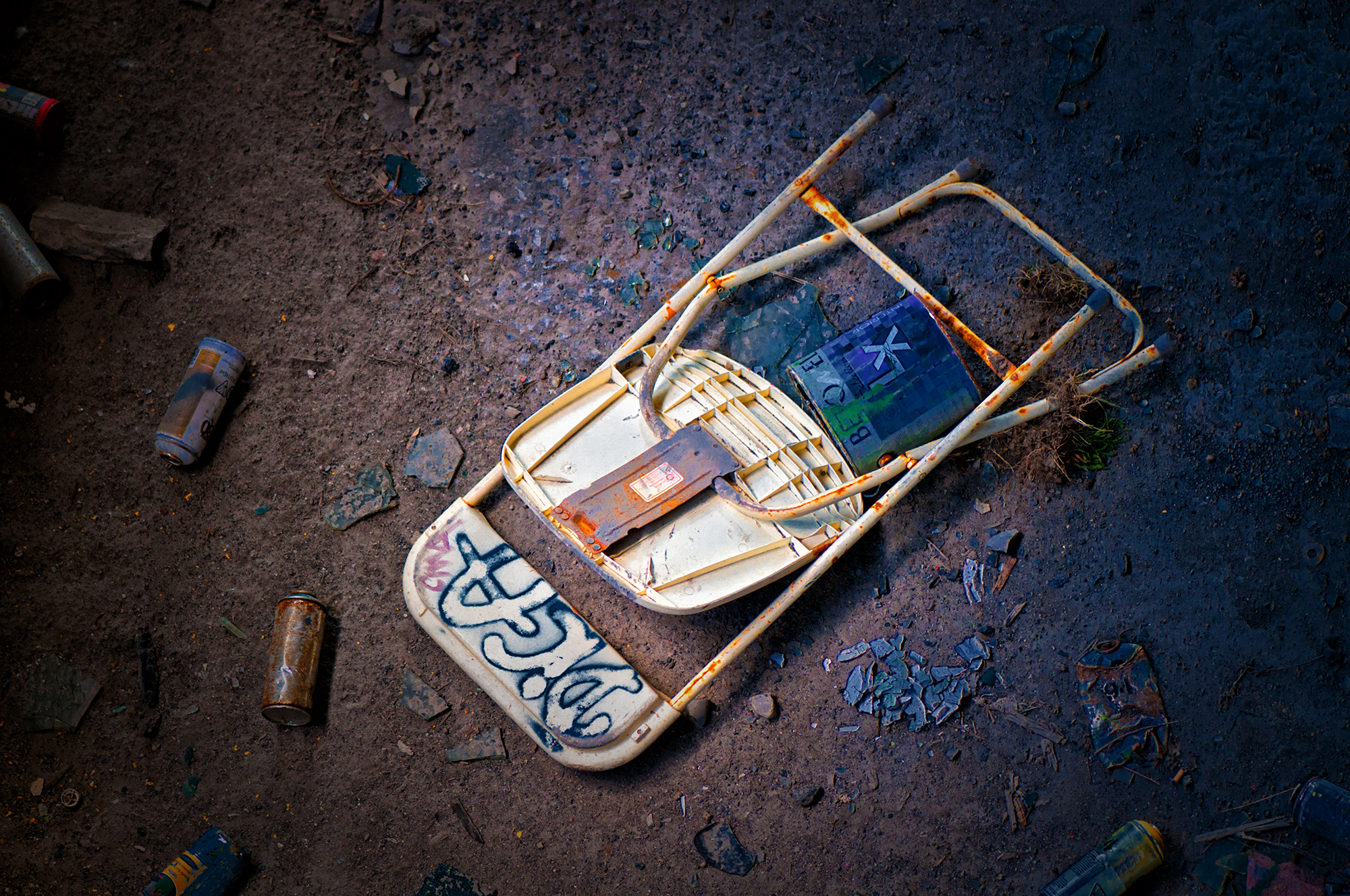 Trash littered an abandoned factory that is chock-full of graffiti. These elements left behind began telling stories.