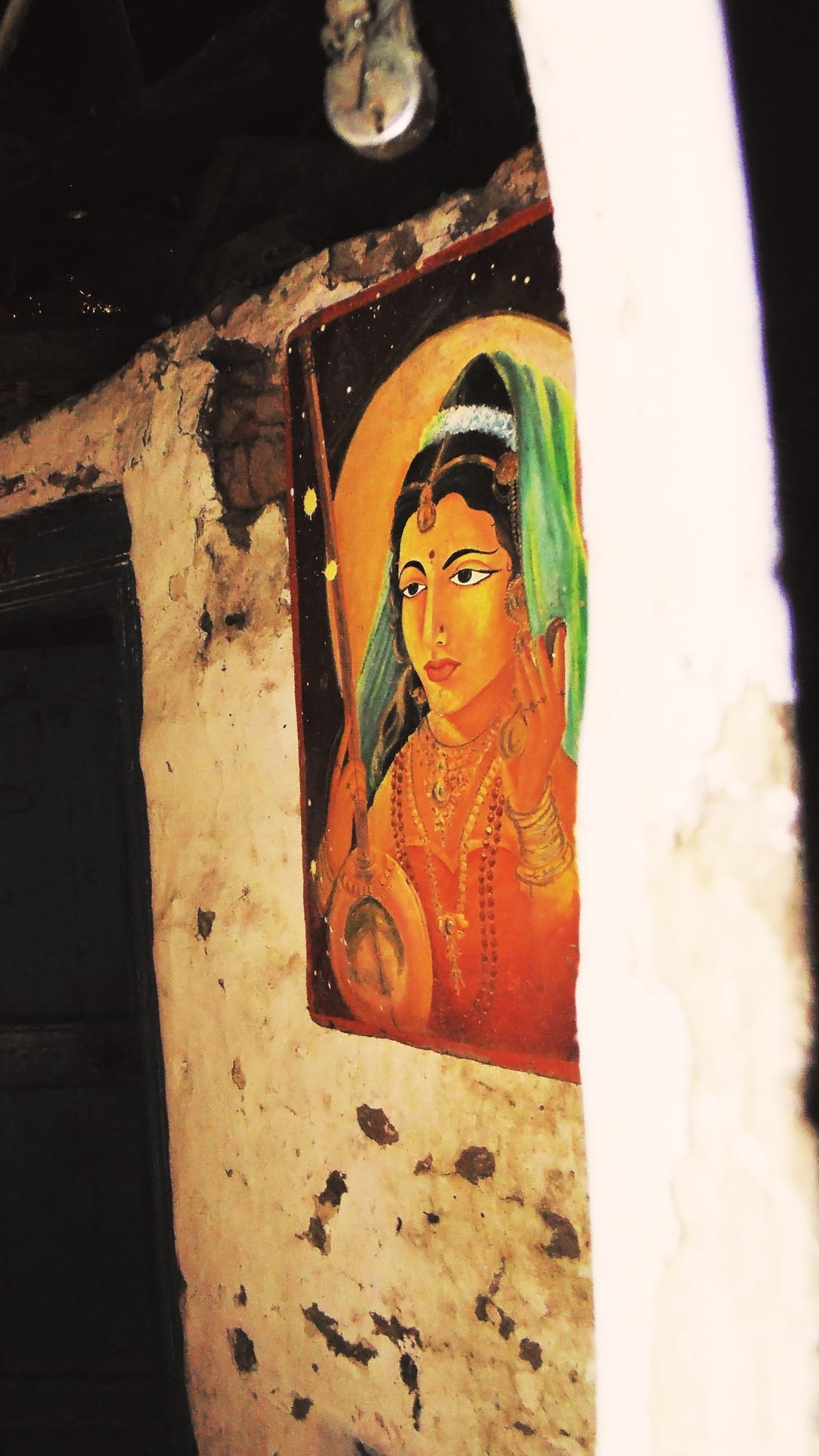 Travelling to a village, i met a person who has a old house., as i entered in it i found this painting which was painted in 2000 by his son...