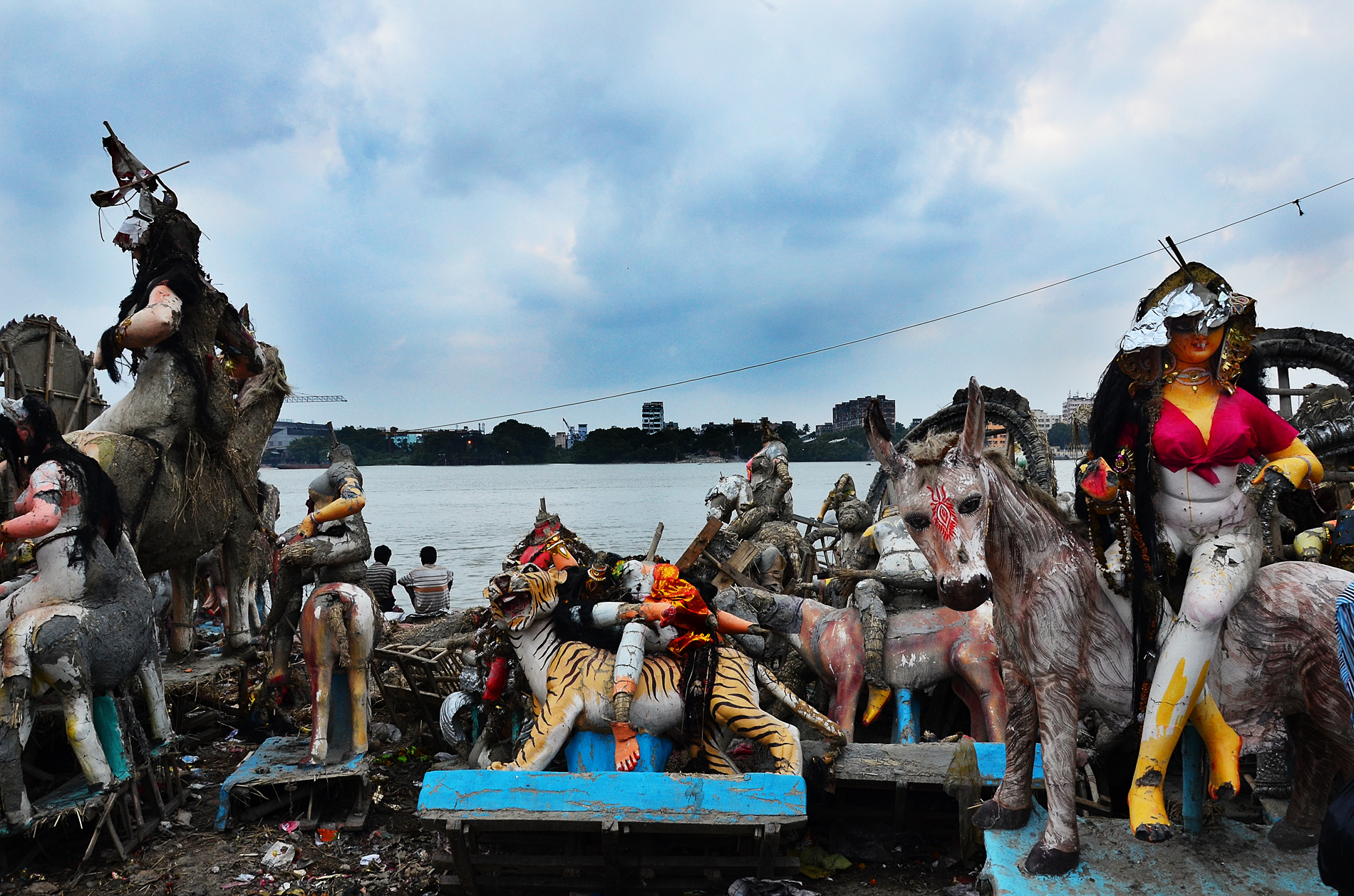 As the black clouds hover over our society we do not respect women any more. These are destroyed idols of different Goddess left over after 'Bisarjan' (immersion), almost depicting our decayed social values mostly in our urban society.