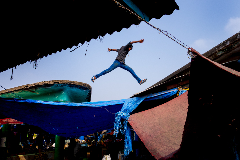 The Markets are generally once built and left forever. Though they stay in the center of the city.The roofs experience leaks and cement keeps falling away.  A kid jumps dangerously in one such market.