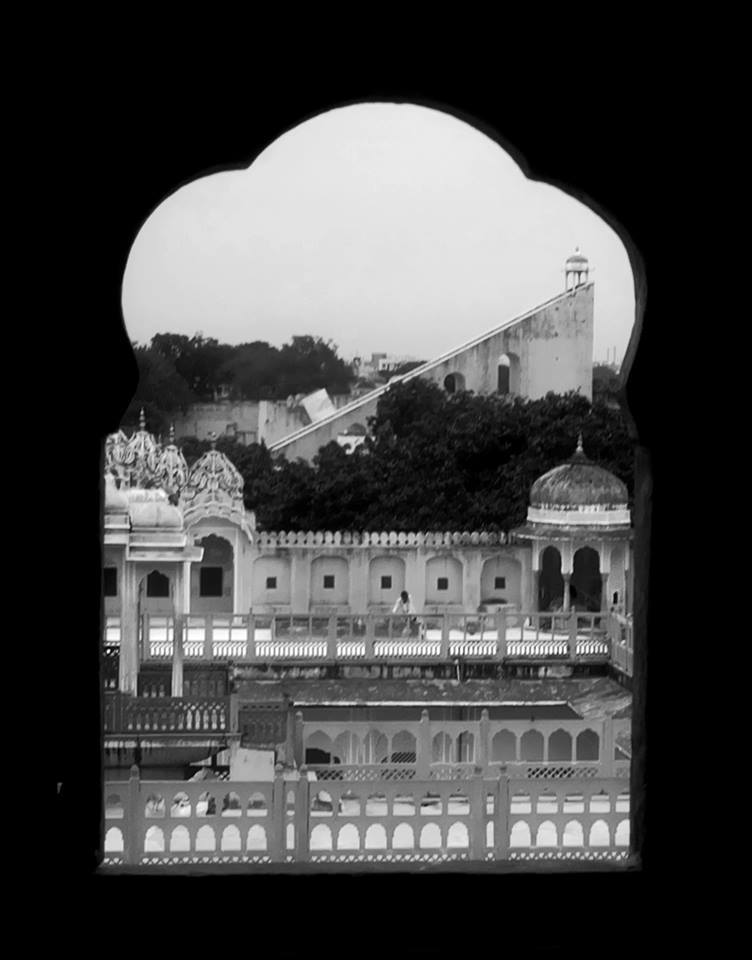 Majestic view of the ancient Jantar Mantar from one of the numerous tiny windows of Hawa Mahal in Jaipur. Truly capturing the spirit of the Pink City.