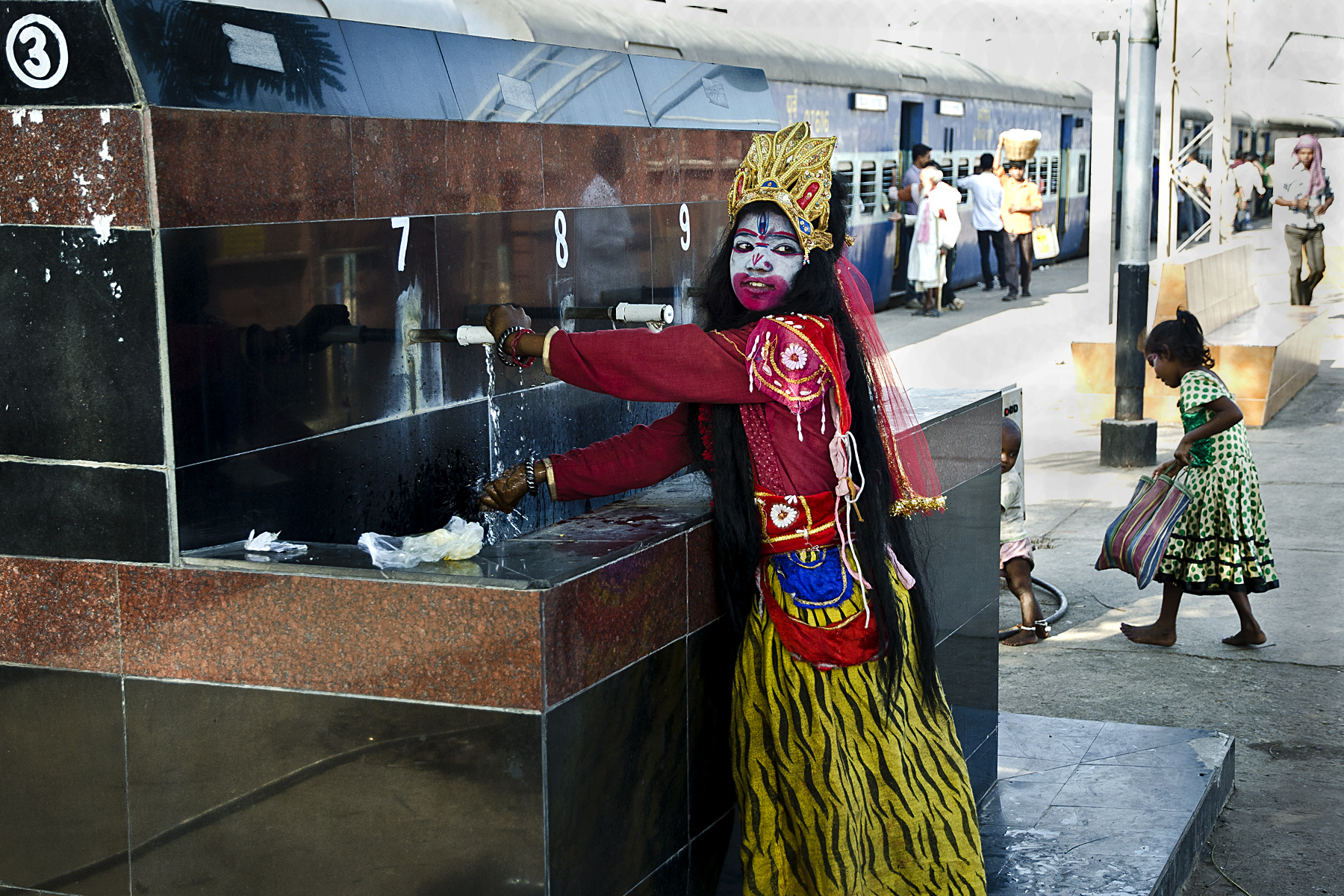 That girl make herself as goddess kali and collecting money from the tourist.