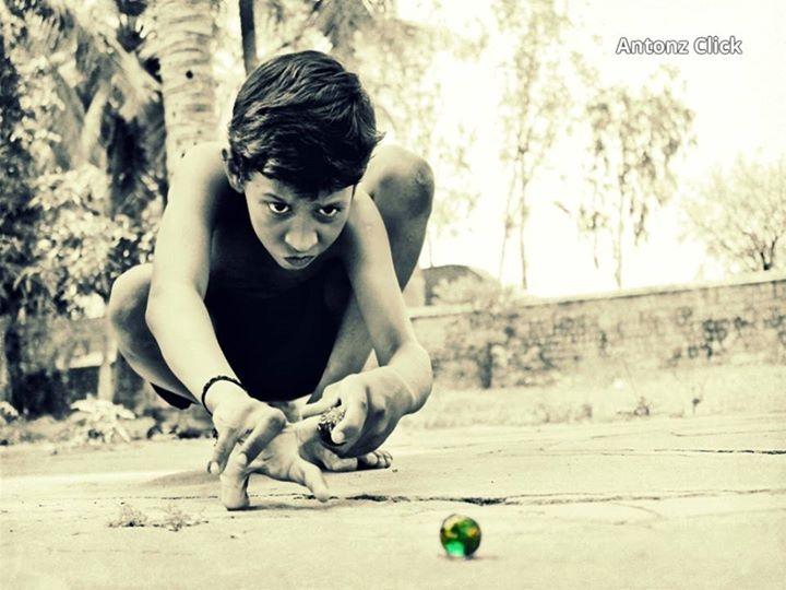 Boy Playing Goli Gundu Photo By Anthony Muthu Tamron