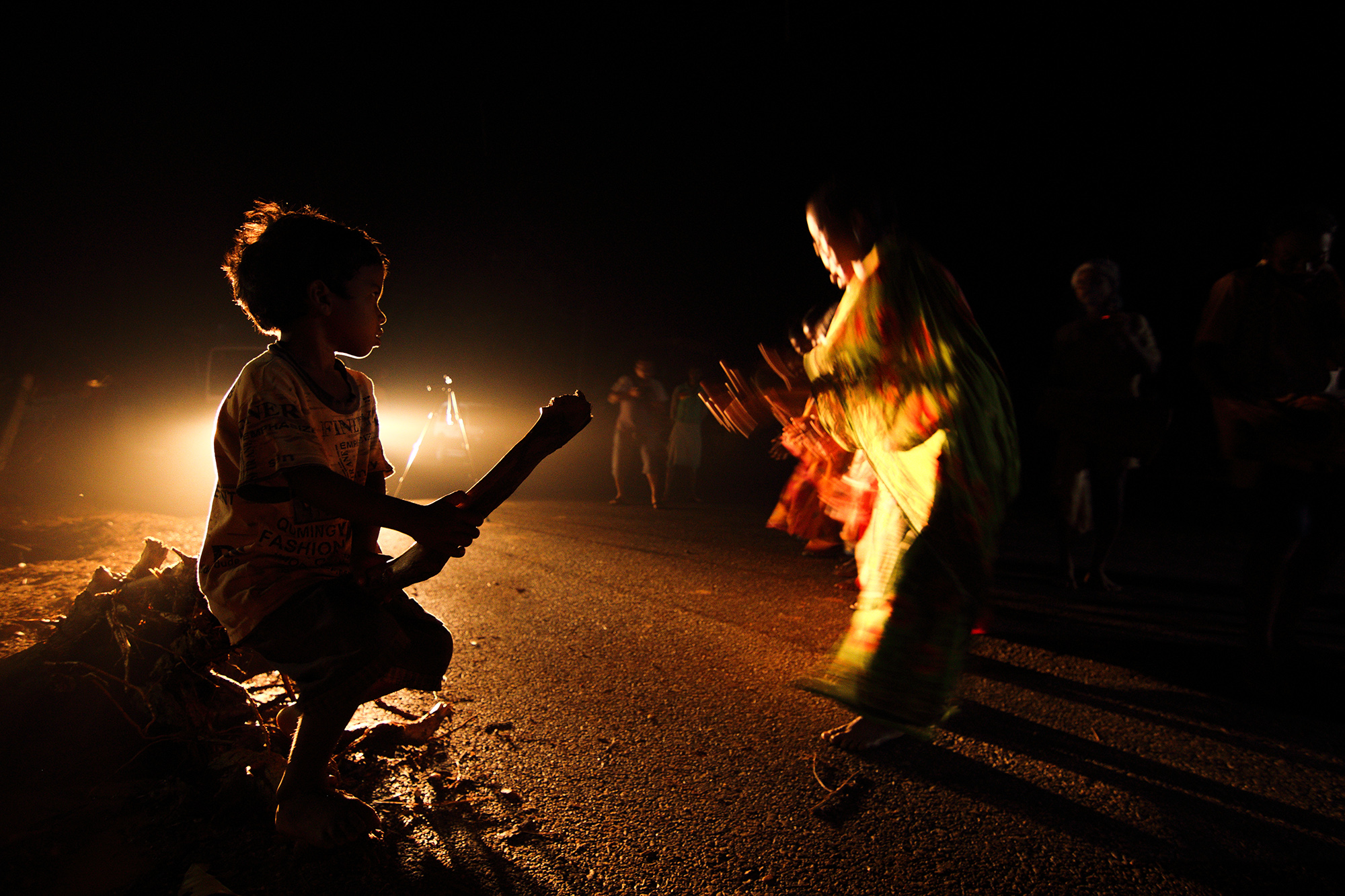 Few weeks ago I have been in Purulia for documenting the ancient culture.I have found some unique incidents there.That night I found this group of people were practicing for their performance.Santal dance form is one of the oldest tribal culture in India.Very few places still have this practice. I was lucky that I have experienced it but I found very calm reflexes from the performers as they dont get regular finance from this ancient dance form as its losing due to lack of grooming amongst them