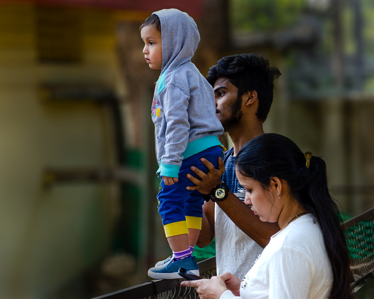 Snapped at Byculla zoo recently, this family is looking over an enclosure of hippopotamus at the zoo. The photographer senses an unguarded moment lingering anytime bringing on unlimited risk to the little one.