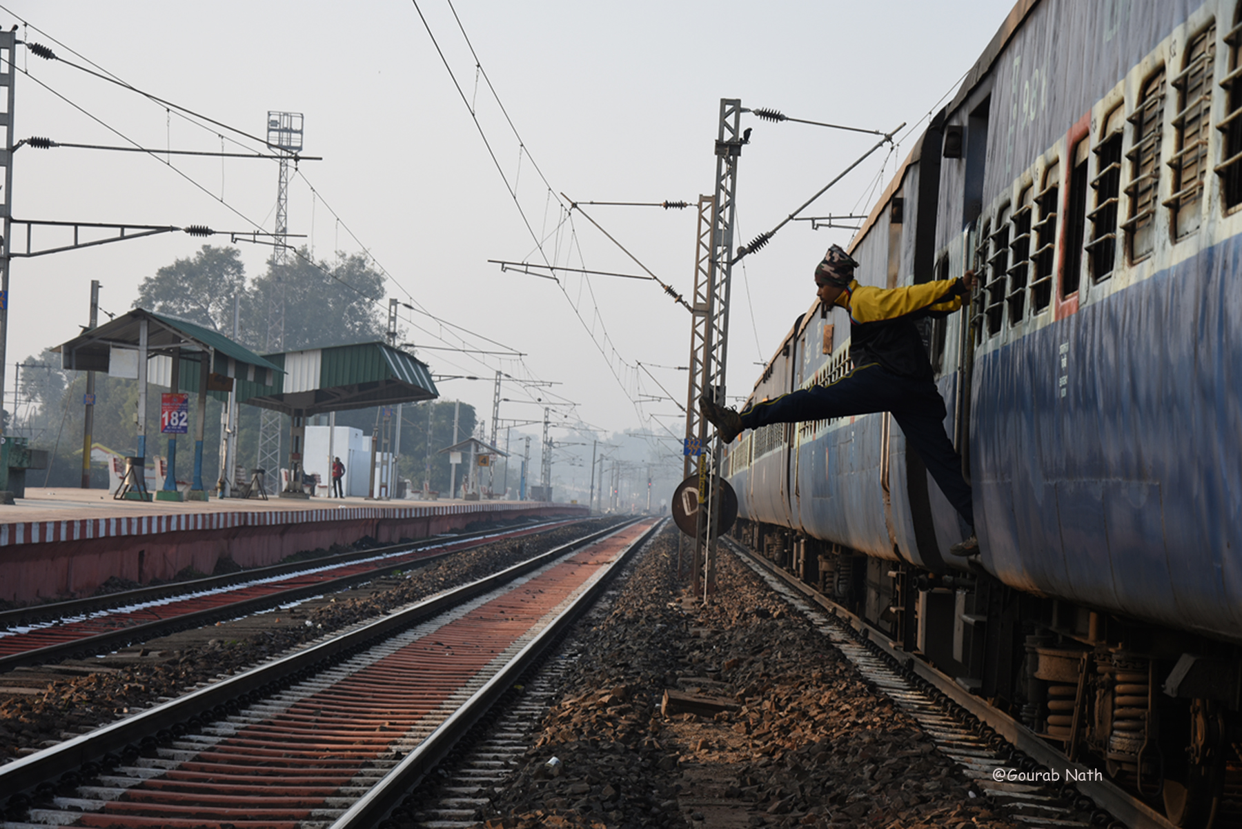 It was captured in the morning at Purulia railway station. The guy was exercise himself.