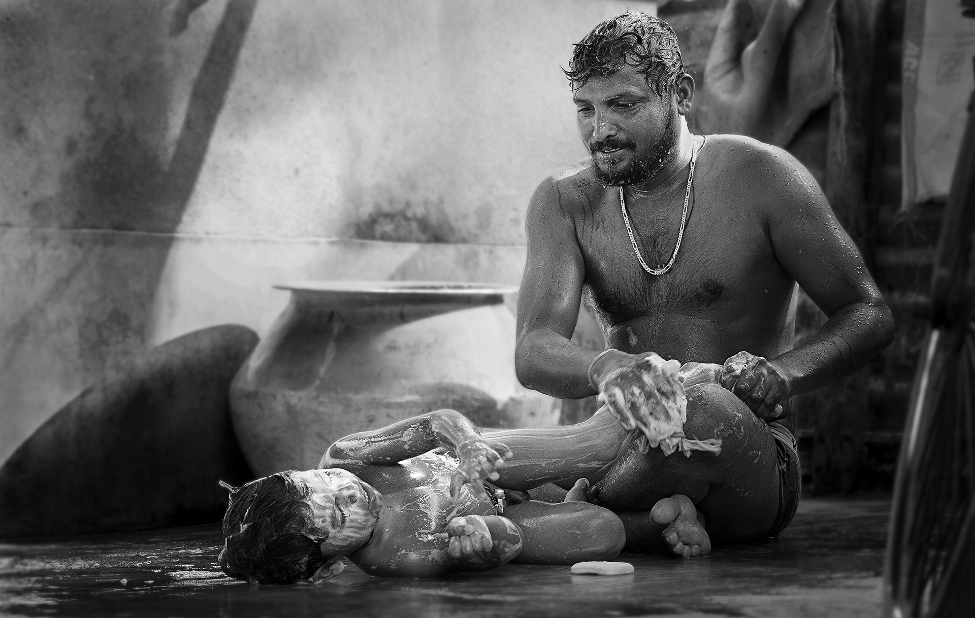 While i was running purpose of a certain work ,suddenly my eye's found that the father was bathing his little child joyfully & the little child was really enjoying that bath.A common story of a family but a very loving and remarkable moment which touched my soul,the moment really inspired me a lot for being a father in future like him.Wish one day I could also love & take care of my child.Cause father is the first unsung hero of a child's eye.