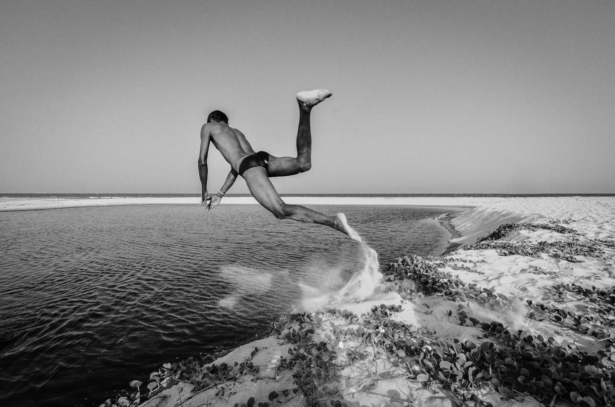 A boy diving on the beach