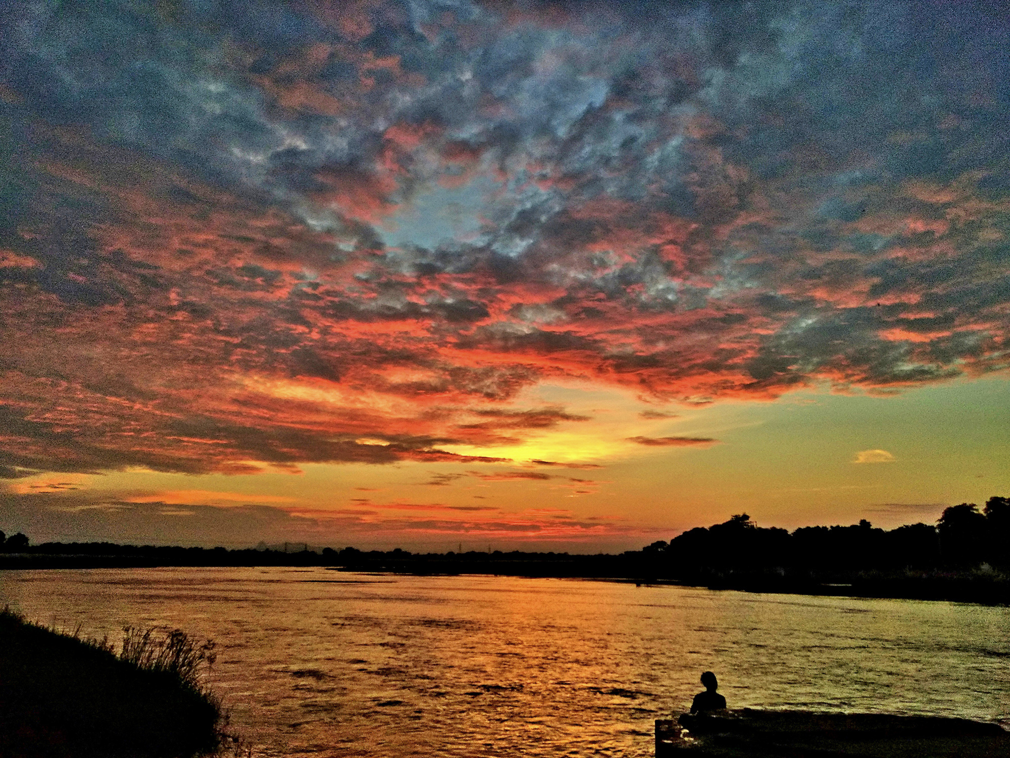 One sunset that I will remember for a long time.Clicked at Kangsabati River in Purulia district of West Bengal the sky turned blood red with a exceptional cloud formation.