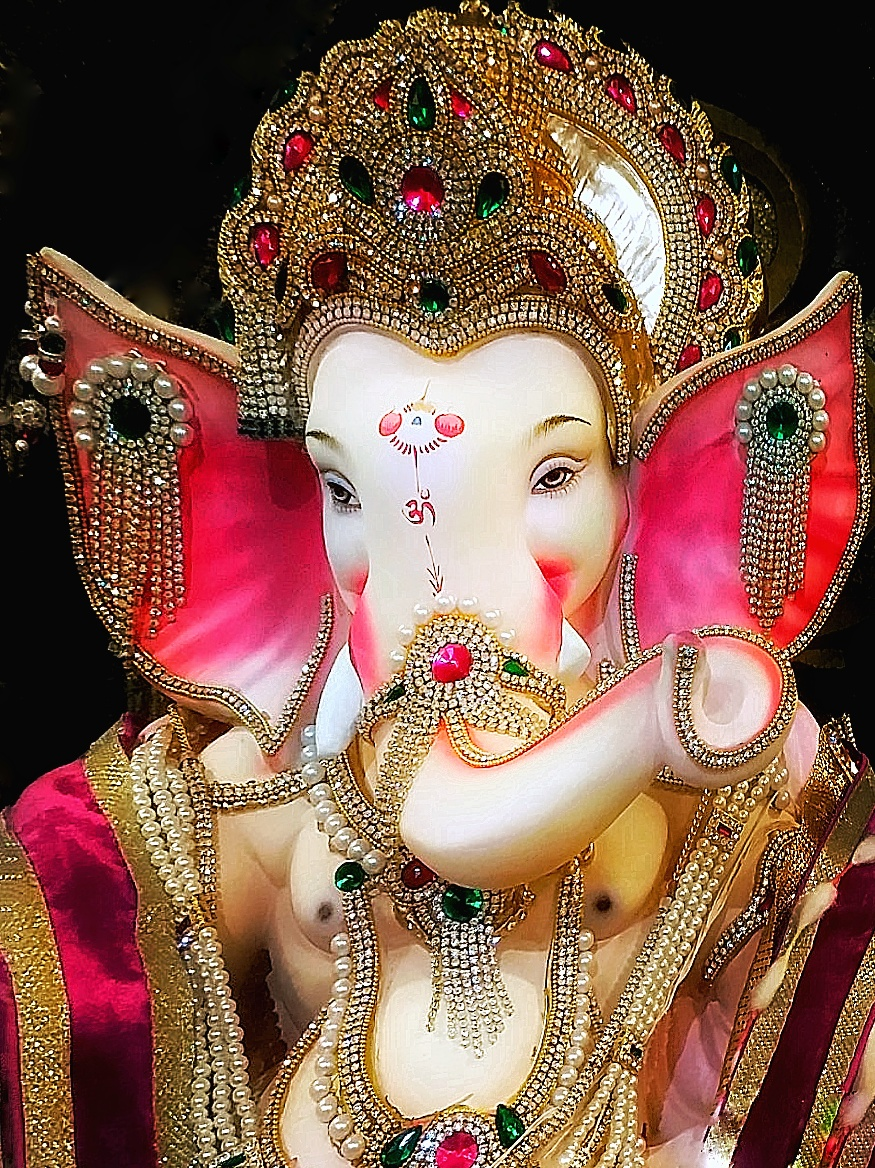 Beautiful idol of Ganpati bappa studied with jewels....