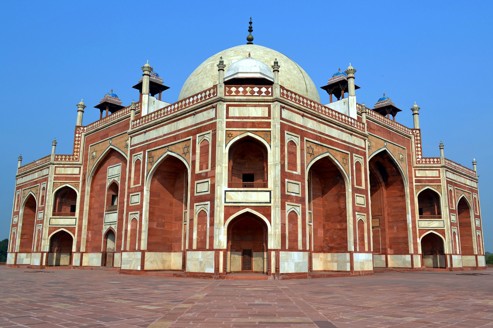 One of the finest examples of Moghul architecture Humayun's Tomb looks perfectly symmetrical from this angle.