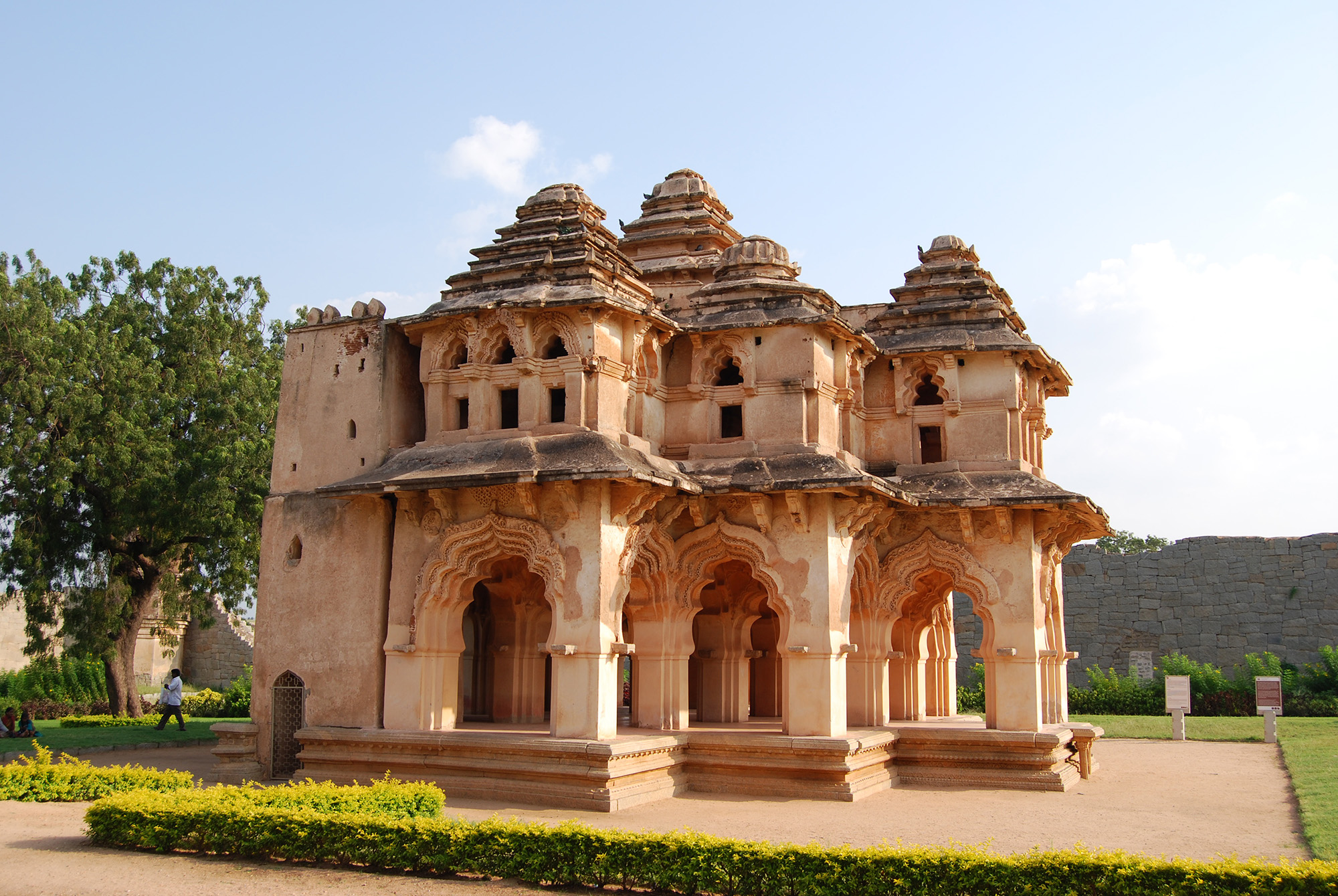 This photograph describes the beauty of the Lotus Mahal located amongst the ruins of Hampi in Karnataka. Hampi is also a well known UNESCO  world heritage site.