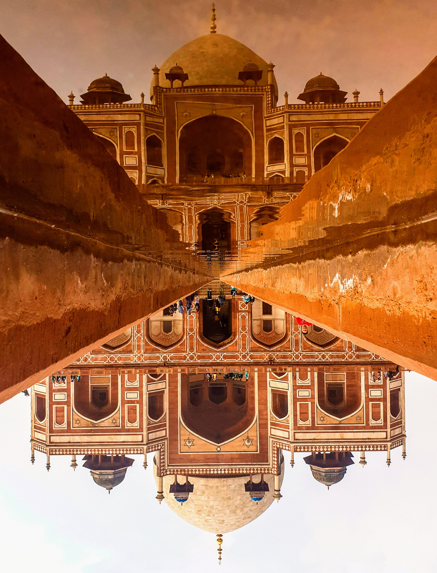 After seeing a lot of photos of  Humayons Tomb, I wanted my photo to stand out then saw a narrow passage of water in front of tomb used the water as a reflection and the small walls being the leading lines shot the Tomb, Its a Treat to watch Architecture through reflection