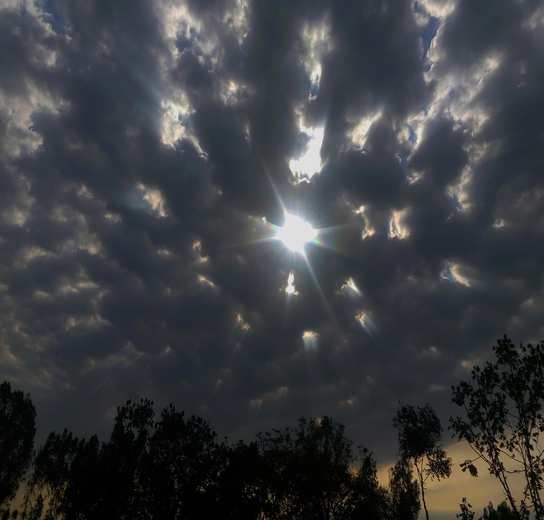 A glimpse of ray flicker through dark sky.