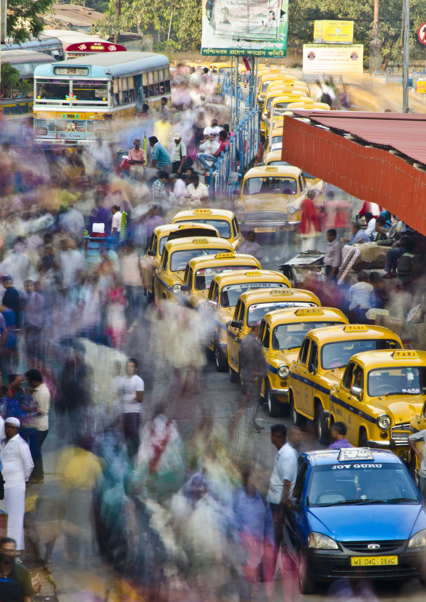 This picture is taken from the Balcony of the iconic Howrah Railway Station. The stationary taxis provide an interesting dynamics to the frame, amidst all the hustle and bustle.